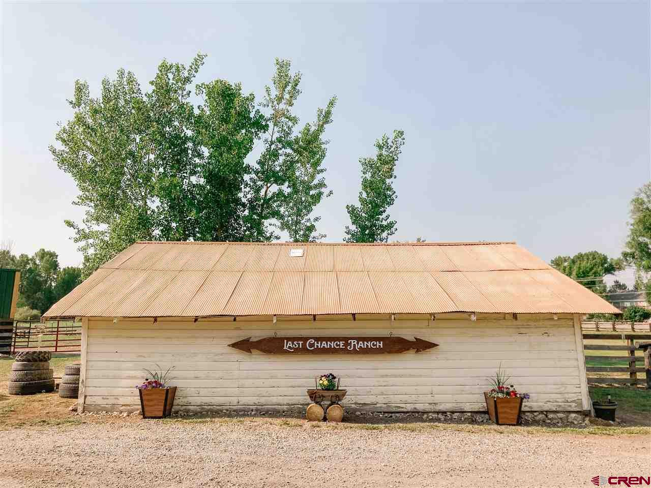 """All the city has to offer in a """"rural"""" package! This undeveloped jewel tucked into the city of Montrose is just an easy walk to the state-of-the-art Rec Center and shopping. An historic 1910 home rests among 100-year-old cottonwood trees on 10.5-acres with views, gently rolling pasture, and ample UVWUA water rights to keep it all green and maintain the two ponds.  This retreat is surrounded by the illustrious subdivisions of Otter Pond, The Brook and Wildwood, making it one of the premier rural/city locations of the Western Slope and an ideal spot to build your own estate home. The existing 1264 square foot 3 bedroom, 1 ¾ bath, two story farmhouse sits in a beautifully landscaped and tree filled yard.  The charming home is tastefully decorated and reflects the architecture and lifestyles of days gone by.  The shaded south facing porch provides plenty of room for outdoor entertaining and relaxing during the warm summer nights. Speaking of lifestyle, the current owners fully enjoy an equestrian lifestyle, and the property is complete with all you need, including a 3-stall shaded barn with riding arena and tack shed."""