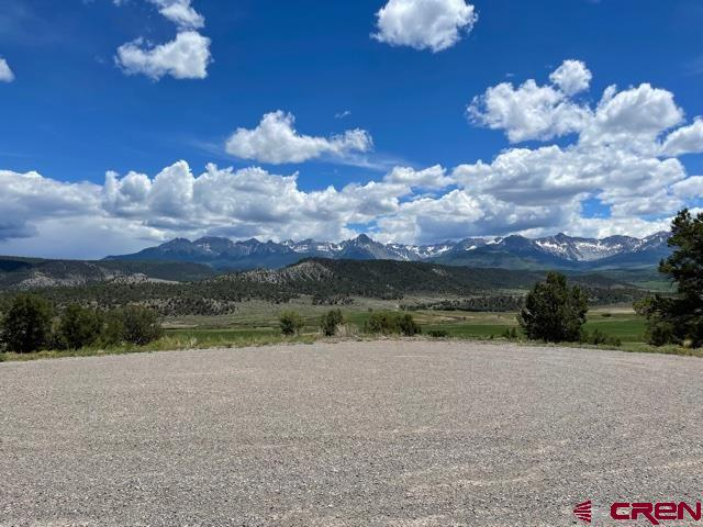 Terrific opportunity to own a homesite in Pleasant Valley. Stunning views of the valley floor, San Juan and Cimarron Mountains make this lot very desirable. Windfall is a small 6 lot subdivision in the heart of Pleasant Valley located west of the quaint Town of Ridgway. Water, phone, power and gas utilities are to the property line. There are various choice building sites each with its own attributes. Sites up from the cul-de-sac, along the existing road, have the utilities nearby. Several sites to the west are more secluded, flat and capture more of the Cimarron Mountain views. See map of Lot 5.