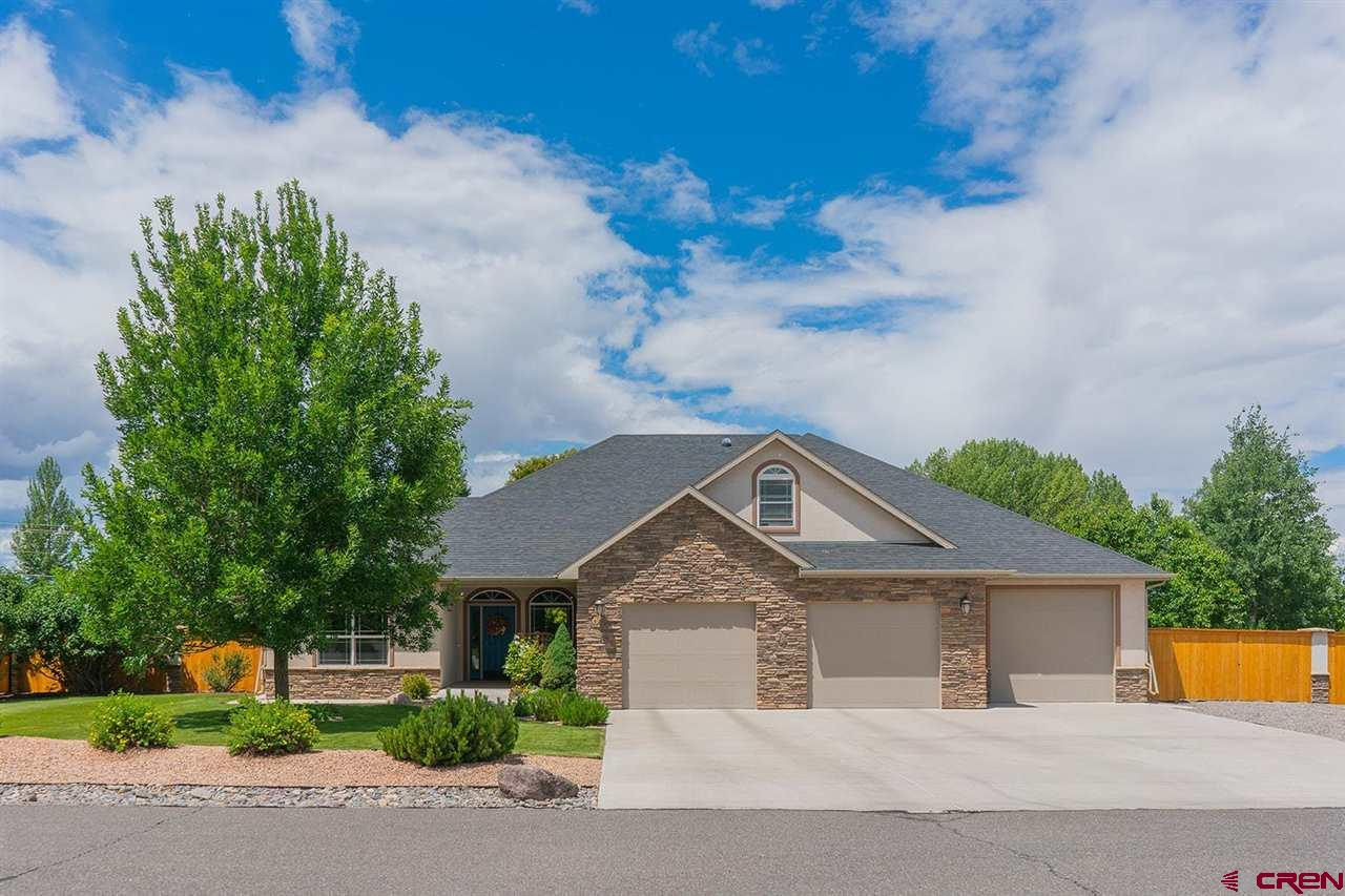 STUNNING HOME in Monte Vista Subdivision. This is a split floor plan built by Byler Custom homes in 2009. It has 2478 square feet of detail & quality. Featuring 9 ft ceilings, which give you the feel of openness throughout. 3BD, 2.5BA & an upper level bonus RM. The kitchen is a dream of any chef w/ the spacious maple cabinets, quartz countertops, upgraded appliances, breakfast bar along w/ dining area and walk-in pantry. The living room offers a cozy fireplace w/ a pellet stove on a thermostat. The master suite is large with double sinks, shower and huge walk-in closets. Newly installed canned lighting and ceiling fan in the master giving more light in the room. The main heating system is a gas boiler side arm hot water loop feeding an 80 gal heat exchanger for radiant in floor heating. The cooling is an exterior wall mounted evaporative cooler thermostatically controlled. The garage is as special as the house with 1559 sq. ft of heated space. The third garage bay is also a tandem garage for not only another vehicle, but all your toys. The garage is equipped with a utility sink, work benches, cabinets for storage, a pellet stove, 2-240 amp outlets and several 120V plugs. A radon mitigation system has been installed with a monitor located in the Master bedroom. There is additional storage attached to the garage with a rear entrance which is a great place for all your lawn tools, mowers and work area. Walking onto the back covered patio brings the openness of the interior to the outside. It has sun shades and a misting system. A great place for sitting and enjoying the Park like manicured landscaping with flowers, bushes, stone and mature trees. Garden spot already in place with water. Recently a new 6ft wood privacy fence was installed on three sides of the home with a new front gate to match. This home is luxury and yet easy to maintain in a favority Montrose Subdivision.   WELCOME HOME TO MONTE VISTA!!!!