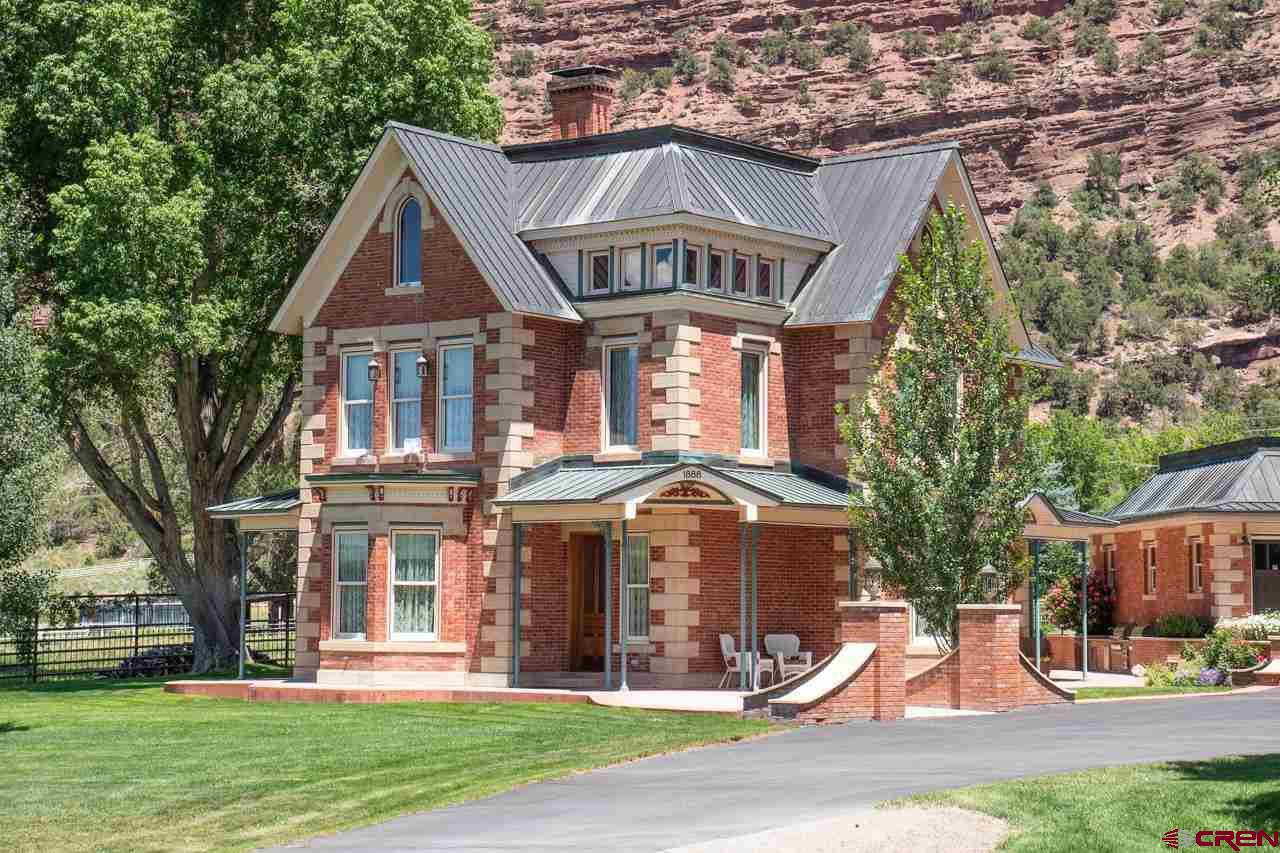 This fabulous Victorian Mansion is located in the beautiful valley just north of Ouray.  It is surrounded by the magnificent San Juan Mountains and is on the National Historic Registry. Construction on the home started in 1886 and was completed in 1888 by George Andrew Jackson who is credited with discovery of the first commercial deposits of gold in Colorado.  Locals lovingly refer to the house as the Poor Farm due to its history as a place for indigent and sick miners from 1914 - 1937. It was later purchased in the 1950's and became a private residence.  In 2000 the home was purchased by a local judge and builder, who started an amazing 10 year restoration project which included completely new plumbing, electric, exterior walls with foam insulation, a copper roof, new sub-floors, a central heating and cooling system, and new doors and windows.  The current owners purchased the home in 2011 and completed the restoration in 2013. The property is truly a must see to appreciate the dedication and hard work that went into this transformation. The custom walnut millwork throughout the home was crafted by a local artisan and adorns interior doors, windows, and baseboards along with all cabinets.  Much of  the original gingerbread still graces the exterior along with original components of the staircase which rises to the second level upon entry into the foyer.  Marble and wood floors are throughout. Reproduction Heartland appliances in the kitchen include two ovens, a broiler, and a warming drawer, refrigerator, and dishwasher to recreate a vintage feel.  The four burner stove is gas. The third story attic was finished with an office space and two bonus rooms. Details show in the three restored Victorian bedrooms which includes an expansive, elegant master bedroom, and three full bathrooms.  The lawn irrigation system is fed by a one hundred gallons per minute water well.  Priority water rights on the Hosner Brownyard ditch feed the pond and over an acre of agricultural 
