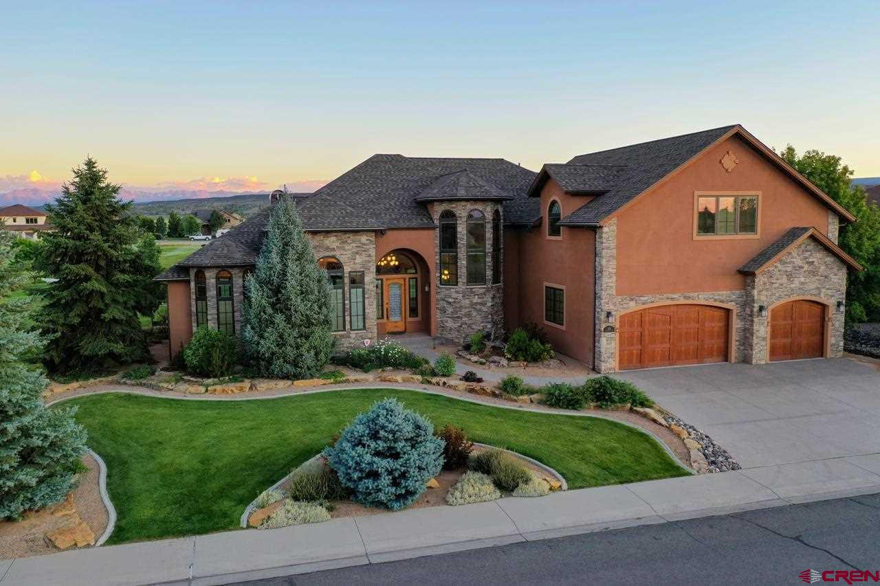 """Characteristic Colorado Home with Stunning Fairway Scenery and San Juan Mountain Views! An expressive and distinctive home adorned with only the finest custom design finishes in a renowned setting. The grand entrance of the home invites you to an open floor plan with spacious cathedral ceilings and remarkable mountain views framed in stone and pecan hardwood accents. Snowcapped San Juan views can be enjoyed in the main-level master, great room, dining area, and guest suite. With views protected by a lush and sprawling fairway, you'll rest easy in this truly irreplaceable investment. Entertaining guests and loved ones is easy as the grand room effortlessly flows into the kitchen and bar area. The upgraded granite accented by pecan cabinets brings a classic Colorado feel to any festivity or occasion. Celebrate life and watch the sunset with a cocktail in hand on the shaded back patio. Stylish wood ceiling accents and views of Cobble Creek's fourth fairway adorn this fun outdoor living space. Immerse yourself in this welcoming home and community, which includes a social membership with golf and spa amenities. Separate RV parking compliments the double-deep and heated 3-car garage, providing ample space for your outdoor pursuits. Lightning-fast fiber internet is available to accompany the executive office workspace. The true definition of """"Living the Dream"""" awaits you. Private Showings Upon Request."""