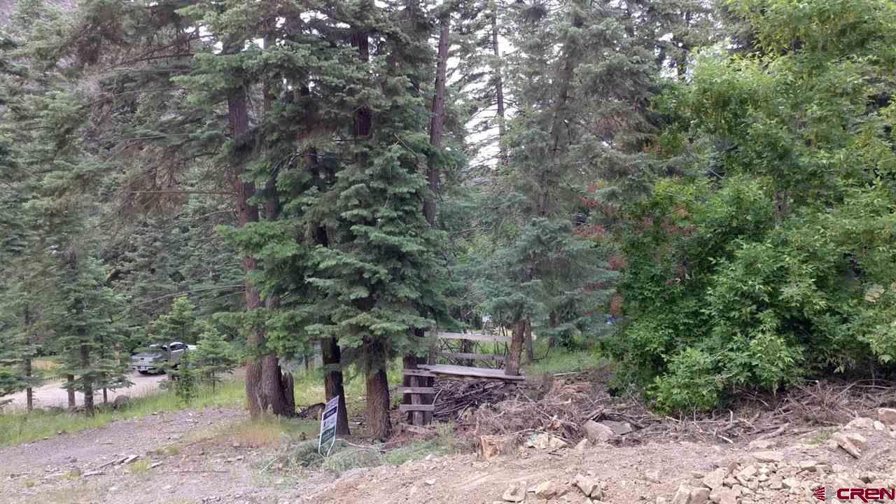 Nice lot within the City of Ouray limits. All utilities at the lot line and ready to build. Some nice trees and views. Walk to the Pool on the North Ouray Corridor trail system connecting to the virtually unlimited hiking on public lands. Vacation rentals are allowed in this area. Ready for your mountain dream home.