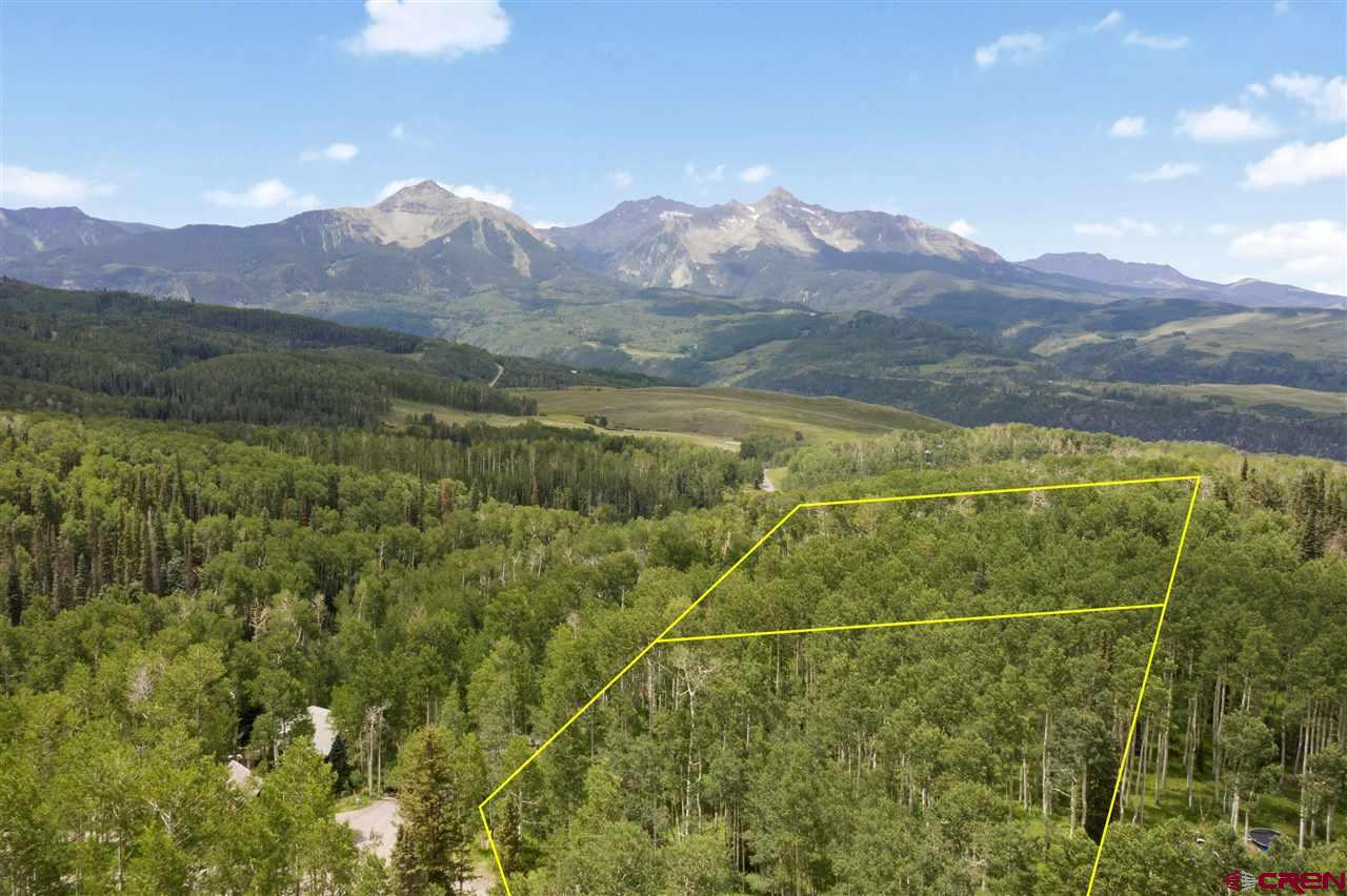 This gem of a parcel in the Telluride Ski Ranches encompasses 2 lots on over 5 acres with an incredible knoll top homesite location and panoramic views spanning the Sneffels Range to the Wilsons. Build a large or small home with ample space surrounding your dream home, or develop the ultimate compound property which is very close to the ski area, biking trails and other town amenities. Properties like this don't become available often. Take advantage of this premier offering in the highly coveted Ski Ranches neighborhood.