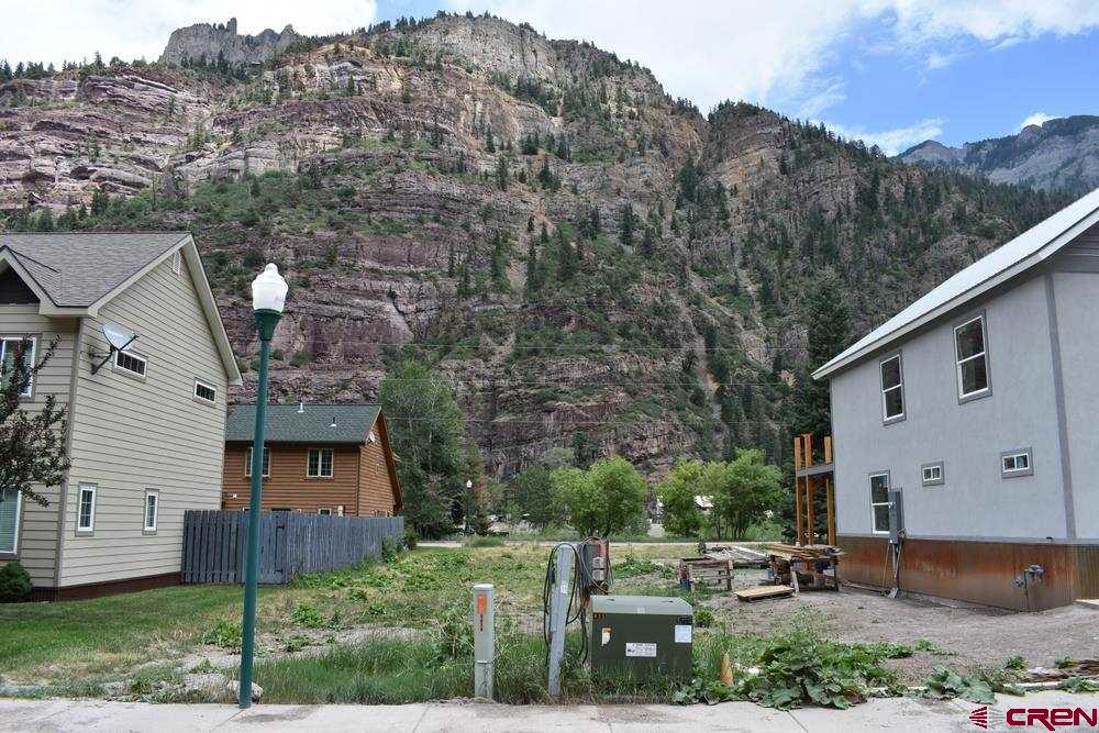 Ready to build flat lot in the city limits of Ouray! All utilities are to the lot line and the lot is ready to be developed. There are mountain views to the front and back of the lot. The river walk trail is accessible across Oak street and it is a short one mile walk into the heart of town. Come see this charming lot today.