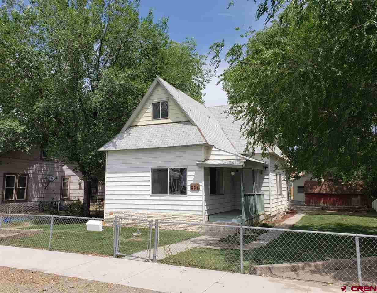 Lots of space in this 1555 sf 2 story home.  3 bedrooms and 1 bath.  High ceilings add to the open floor plan feel. This home is ready for renovation or remodel.  One car garage & parking off the alley.  Close to downtown Delta.  So many possibilities for this home.