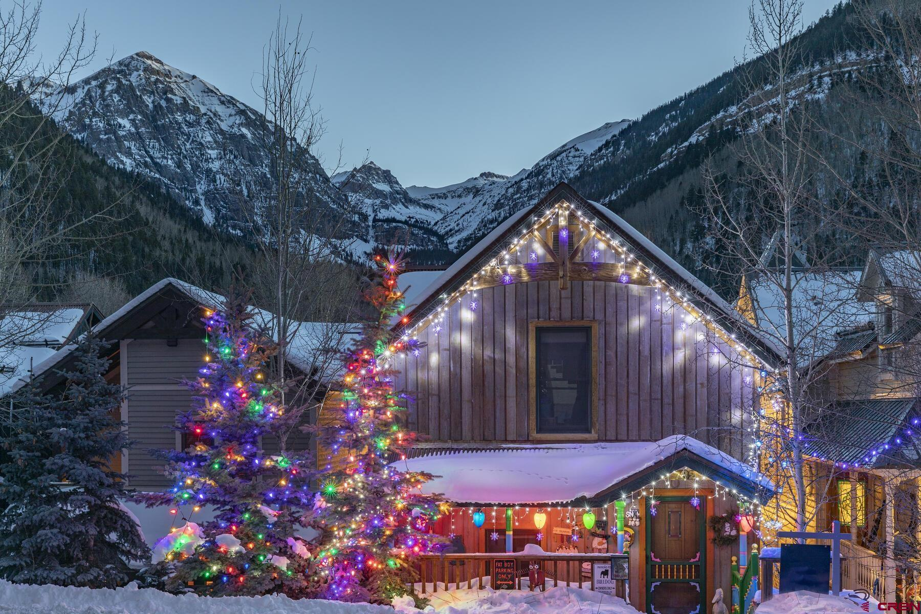 Located in quiet East Telluride, this sun splashed five bedroom and two bath residence represents a wonderful opportunity to call the town of Telluride home, whether for a few weeks per year or a lifetime.  Big views of Bear Creek and Coonskin area of the Telluride Ski Resort.   The lower level features a garage, alley entrance, one bedroom, one bath and flex space currently used as a game room.   The great room, one bedroom and large south facing deck sit on Columbia Street level. The master suite and two additional bedrooms are on the third level.  A local contractor built the home for his family, so even the most discerning Buyer will notice the quality of construction.  Designed by longtime local architect, George Greenbank.  A short walk or free Galloping Goose ride to all of the amenities of Telluride Town Park, including the famed music and film festivals as well as the fine restaurant scene.  Live in the home, while you design a new interior for many future years of enjoyment.