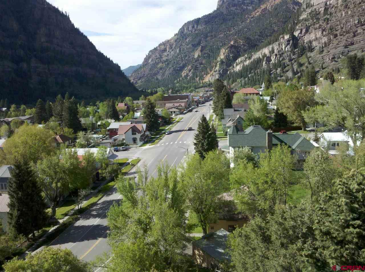 Build your dream home in the Colorado Mountains in Ouray! Phenomenal views over town down main street and up to the Amphitheater, Twin Peaks, and the surroundings. Lot is ready to go with all utilities. High speed fiber being installed in town. Make a change to a better lifestyle in a peaceful mountain town.