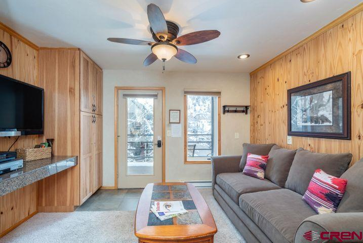 Gaze out over the San Miguel river to the ski slopes and surrounding peaks from your perch on the top floor of the coveted Viking condominium complex. The ''Viking'' is ideally situated on a river trail promenade that runs the length of the Telluride valley and offers an idyllic stroll to Telluride's historic commercial core just a few blocks away. Or jump on the ski lift within a stone's throw and be whisked off to Telluride's world class ski runs. Remodeled and updated with a king bed, twin bunks and a pull out sofa sleeper, this fully furnished one-bedroom gem can accommodate a family and is a rarity in today's market. Custom furniture handcrafted with wood from Ralph Lauren's ranch adds to the allure. The community pool and hot tub boost the rental opportunities.