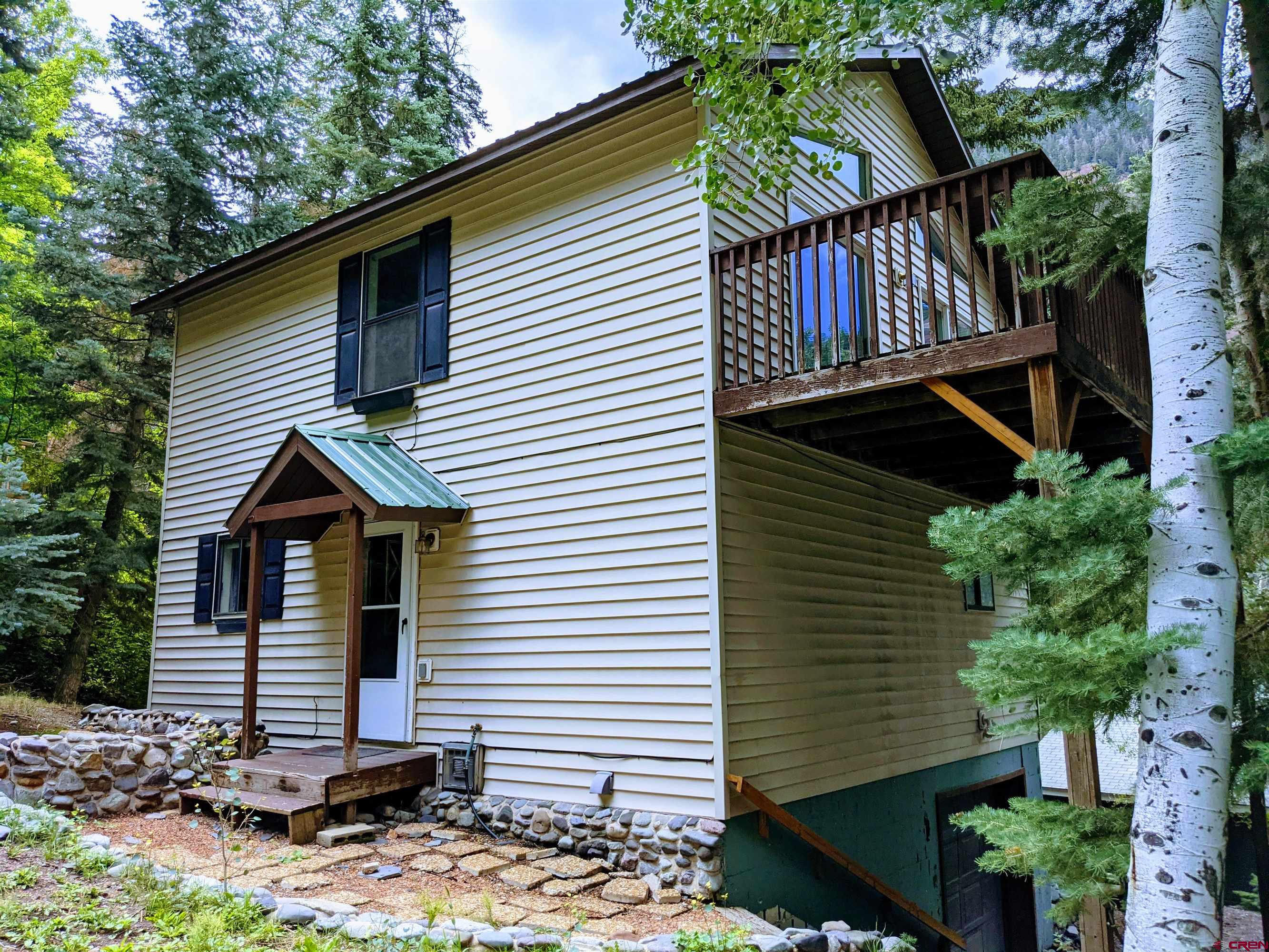 This home is nestled in the pines and aspens on a quiet street and just a 2 minutes drive to the heart of Ouray! Enjoy all that Ouray has to offer and retreat back to this peaceful setting. The river trail is a short walk and is a part of the perimeter trail. You could walk or bike to any Ouray adventure from this location. New luxury vinyl flooring has recently been installed. The vaulted ceiling and large sliding glass doors give the kitchen and family room a nice spacious feel. If you're looking to live or invest in Ouray here is your opportunity! Call for a showing.