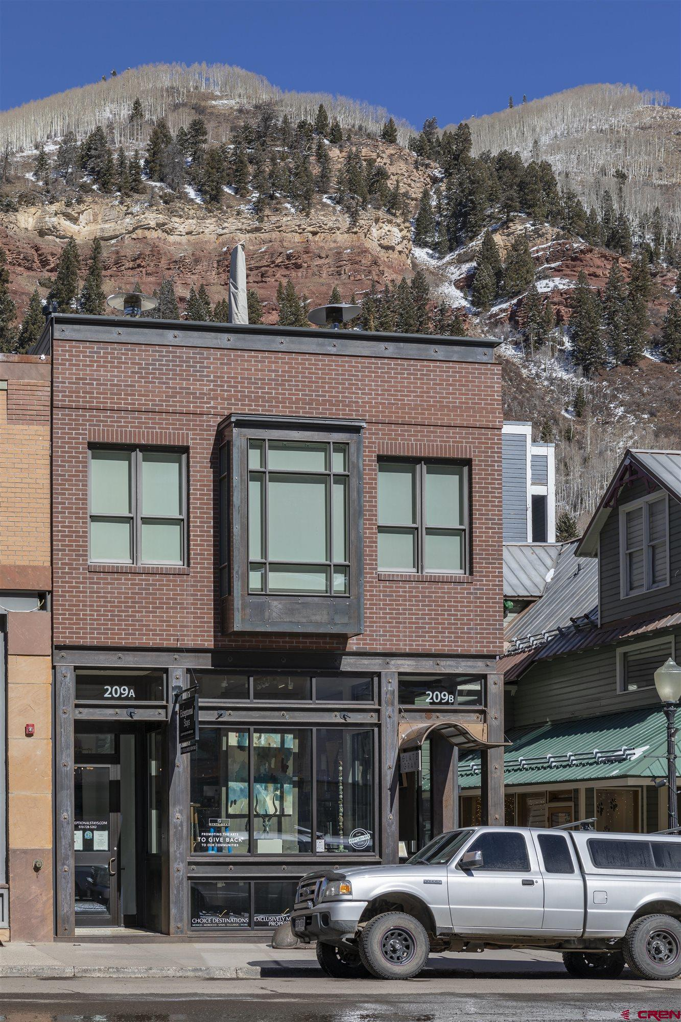 A unique opportunity to own a building on historic Colorado Ave in downtown Telluride Colorado. This 4 unit building constructed within the last 10 years has 360 views from the large patio of the 3900 sqft penthouse condo. Experience the incredible views of of Bear Creek, the box canyon, Telluride Ski Resort, and the Valley Floor. The 4 bedroom luxury 2 story penthouse sits above two high end commercial spaces with solid rental history and great tenants. The building is in the ultimate location for the Telluride downtown area and is complimented with 4 parking spots for added convenience .