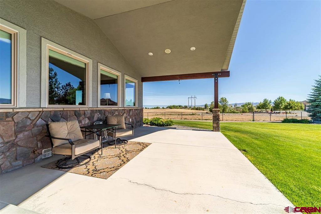 Immaculate 3 Bedroom 3 Bathroom 3800 s.f. ranch style home located in Beautiful South Montrose on a pristine 6.4 acre irrigated parcel.  Brand new 40' x 30' insulated shop with 10' roll-up door and extra attic storage. Convenient 220 volt outlets on the floor and even a welder's  outlet.  This shop and home is a must see!  This custom built home has so many extras:  large windows for natural light, views of Storm king mountain and the San Juans, open floor plan, dreamy chef's kitchen, custom installed $10k Miele refrigerator, Fisher & Paykel two drawer dishwasher, granite countertops, beautiful tile work, Alder wood cabinets throughout, solid wood doors, laundry room off master walk-in closet, jetted tub, walk in rain shower, spacious office, security system,  and several porches on the outside to take in all the scenery. This home and shop are truly a rare find.  Don't miss out... schedule a showing today.
