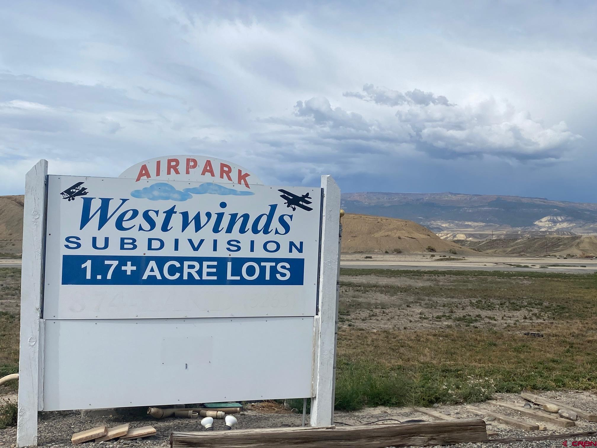 Great opportunity to own a lot on the Westwind's airport right of the main runway.