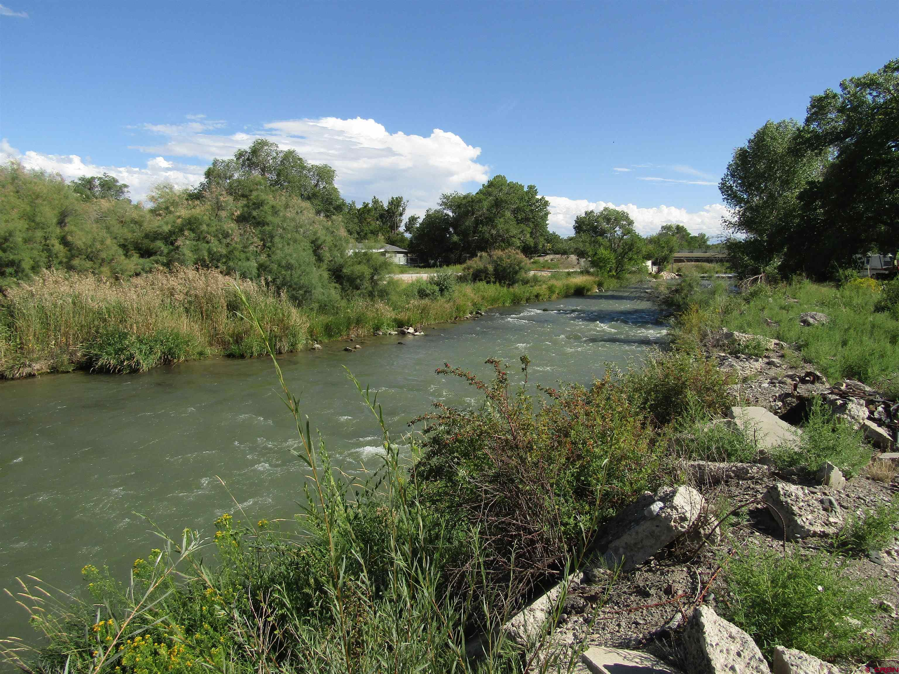 This 4+ acres has over 900' of Uncompahgre River frontage.  Located just west of Montrose, this area of the river is designated gold water fly fishing.  Rivers development potential with possible connectivity to Mayfly development North and to the South.  Montrose water & kayak park.  The development possibilities are endless!  This is the last piece of the puzzle on the river.