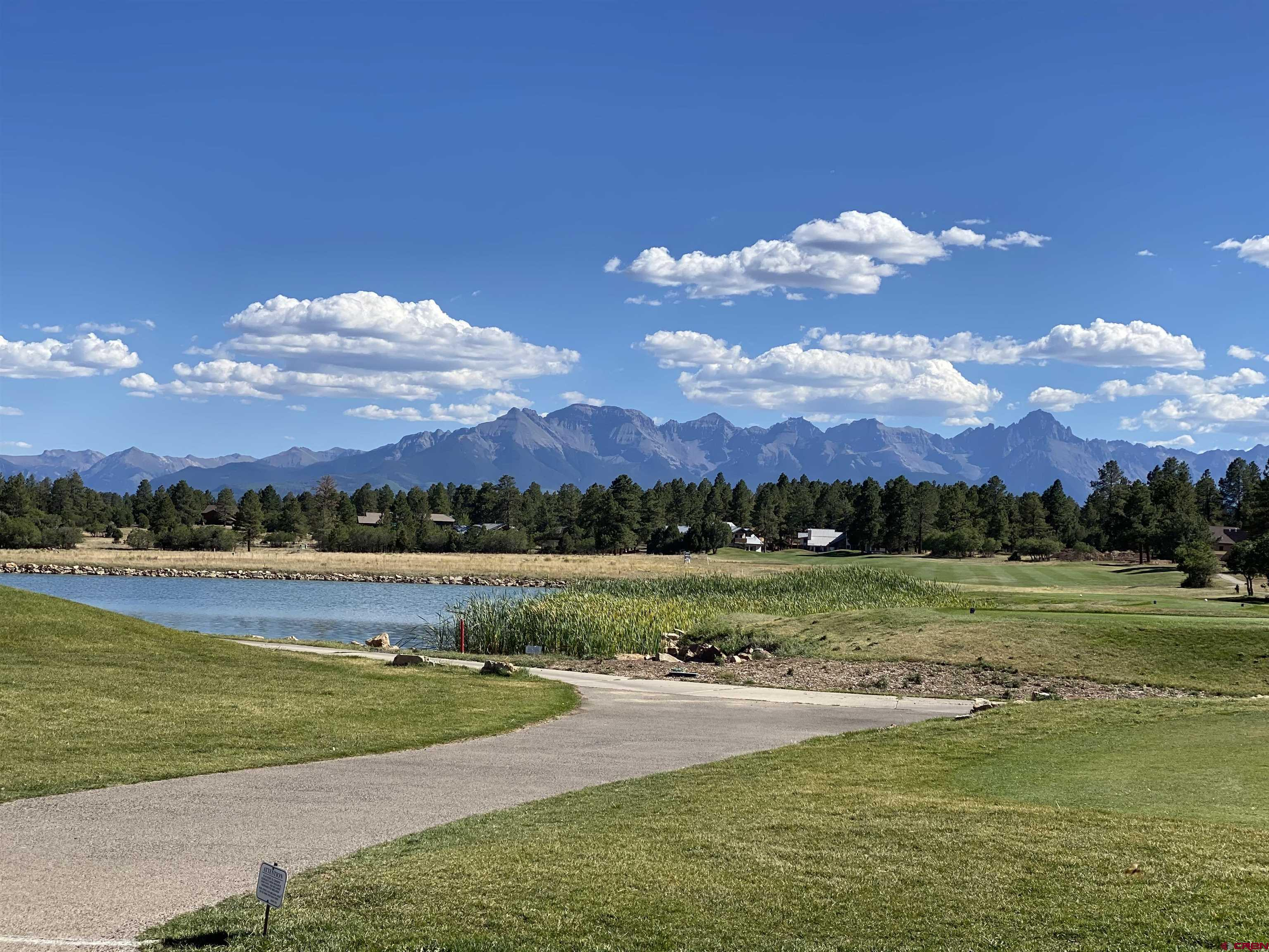 Level building site with many big Ponderosa Pines. Fronts the Divide Ranch and Club golf course 7th hole, sweeping views of the Cimarron Range.