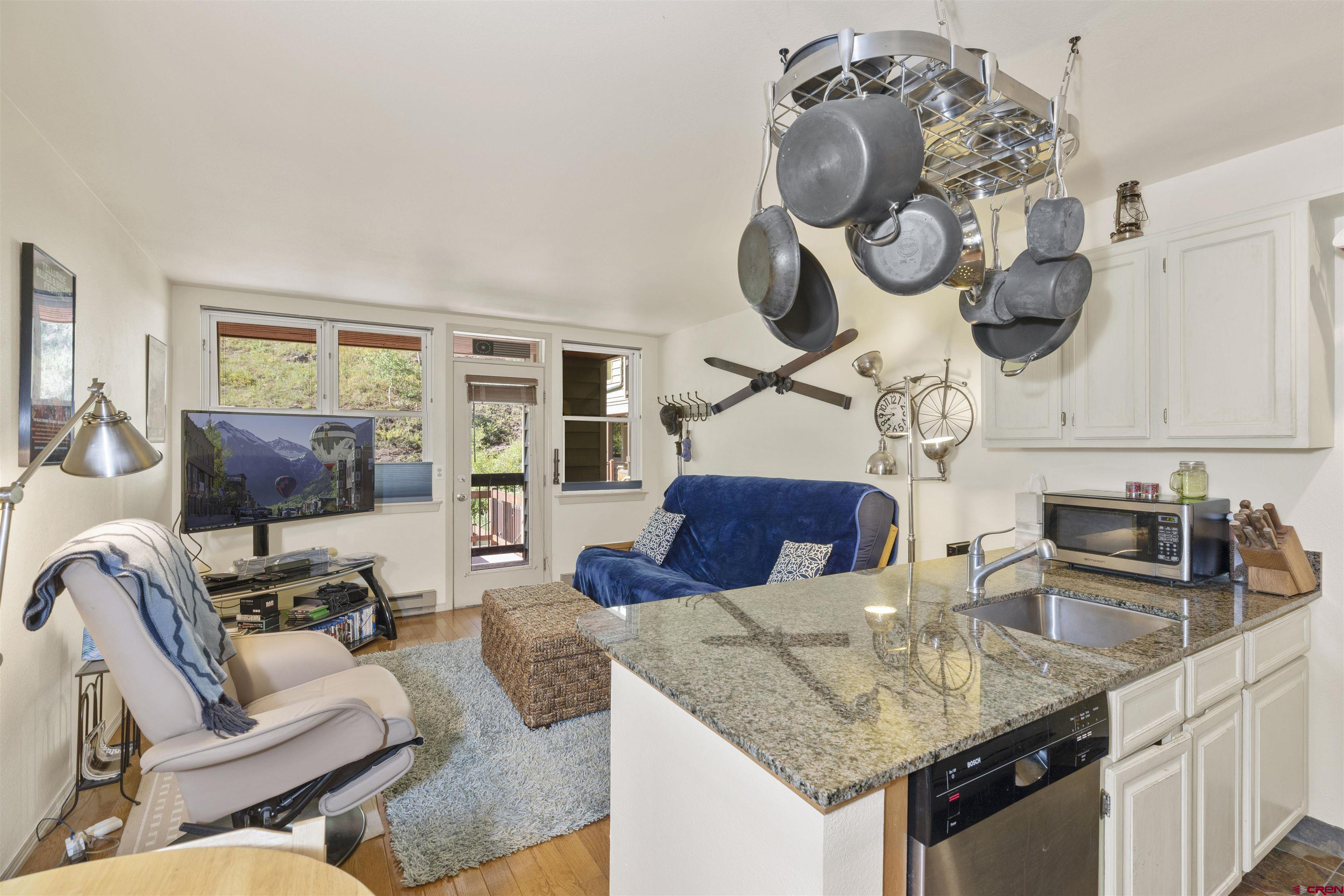 Sitting just steps from Lift 7 of the Telluride Ski Resort and the San Miguel River Trail, this ski in/ski out one bedroom/one bath Etta Place condominium is an exciting opportunity to call the town of Telluride home., whether for one week or a lifetime. The unique layout does not share any walls with a neighbor. The upscale finishes feature wood floors, stainless appliances, granite countertops and so much more. Parking is offered below the unit. The local transportation system stops in front of the complex and can take you to downtown Telluride, The Gondola to Mountain Village and Telluride Town Park. A strong rental income is possible with this Rocky Mountain Ski property.