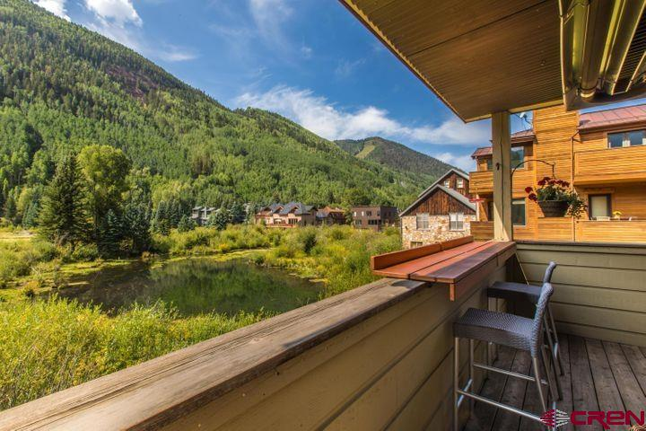 The best-kept secret in Telluride could be yours! This single-level 3-bedroom (plus flex room) is situated 3 blocks from the gondola but offers innate privacy exclusive to this nook of town. Your backyard is the river trail, duck & beaver ponds, & a large swath of nature, while sweeping mountainside views accentuate the skyline. Enjoy festivals from your heated deck or head downstairs to spree at a boutique store. This pad is steps to Main Street but away from it all. It has no shared walls & only one neighbor upstairs. The location is just the beginning - the interior was remodeled in 2018 with upgrades to bright and airy kitchen & living spaces. The private elevator is perfect for older pets & easy on the knees. This is truly the best townie hideaway in Telluride. Come make it yours!