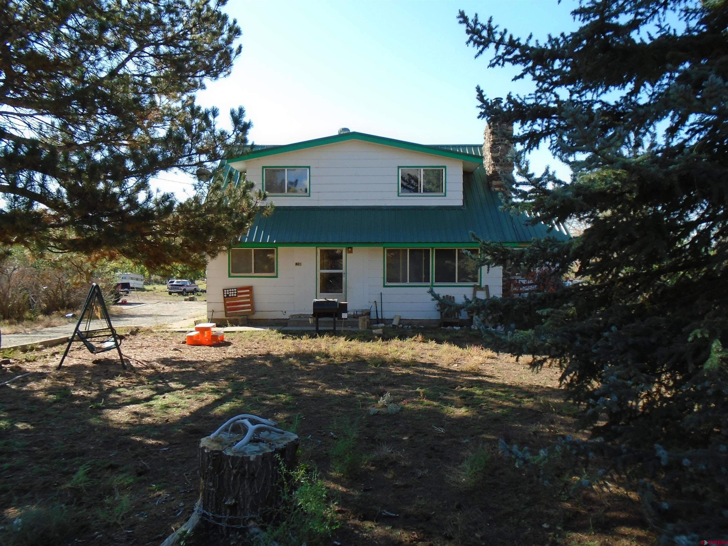 This is a Great Family Property.  The home has 4 bedrooms and 2 bathrooms with the master bedroom on the main Floor.  The Living Room has a beautiful stone pad and wall covering  on which there is a wood stove which can heat the entire home.  The kitchen has lots of light from windows looking toward to the Grand Mesa.  There are several sheds and a one car garage that provide storage and shelter for animals.  There is plenty of room for animals, 4-H projects, etc. The Property is close to Town and services. This property is showing a little wear and could use some TLC.  The 3 acre property has 2.7% interest in the Coldwater Ditch  which has a #29 decree for a total of 1.62 cfs plus 10 shares of Leon Lake Stock.  All Livestock panels are excluded