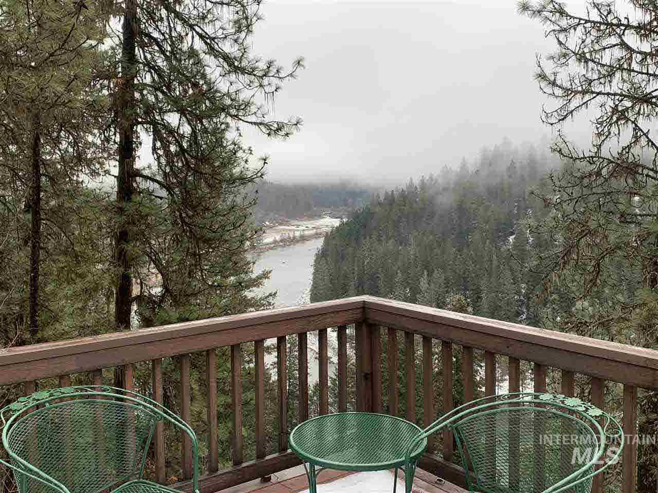 MOTIVATED TO SELL! Located on the MIDDLE FORK OF THE CLEARWATER is this 3700 sf home on 36+acres. Ample wildlife, shop RV bldg., fruit trees, timber, river view; SPORTSMAN'S PARADISE! Gorgeous house w/master bdrm/bath, formal living/dining w/open floor plan and kitchen on main, 3 bdrms/3/4 bath, kitchen, family/game room plumbed for bar w/wood stove, laundry room & walk-out in basement. Water rights from the river, spring, 1200 gal. storage tank, & numerous extras. Give us a call!