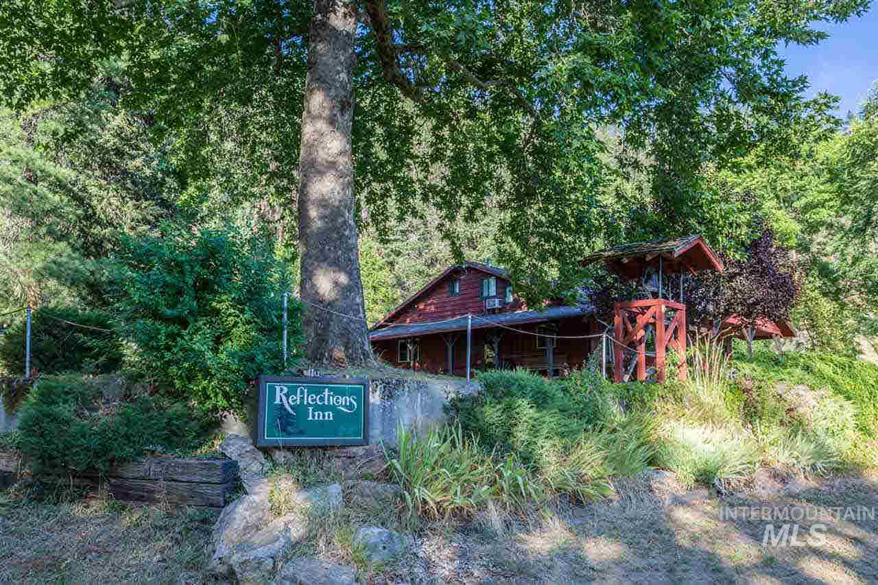 Here's your chance to own a premier hospitality property on the Middlefork of the Clearwater River w/access to state land bordering Natn'l Forest. Main house has a large dining area, commercial kitchen, office space & private living quarters. The 3200 sq' 8 room guest house has a kitchen, laundry room & outdoor seating area. A 1 bdrm cabin, garage/shop, hot tub, shelter house, garden area & fruit trees are some of the amenities that come with this turn key business opportunity. Live & work in paradise!