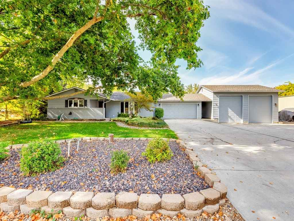 New Paint & Improved Price! Gentleman's farm in Boise! Rancher with 4 bd/3 full bath, 2 separate living spaces. One living space has own kitchen & bath plus an outside entrance.  Kitchen updated with granite, SS appliances. Bamboo Floors, Formal dining, huge great room opening out to covered deck, fire pit and gazebo perfect for entertaining. Main master also opens to deck w/wired area for  hot tub. 2-car attached and 2-car unattached garages. Plenty of room for RV and toys. Horses welcome!