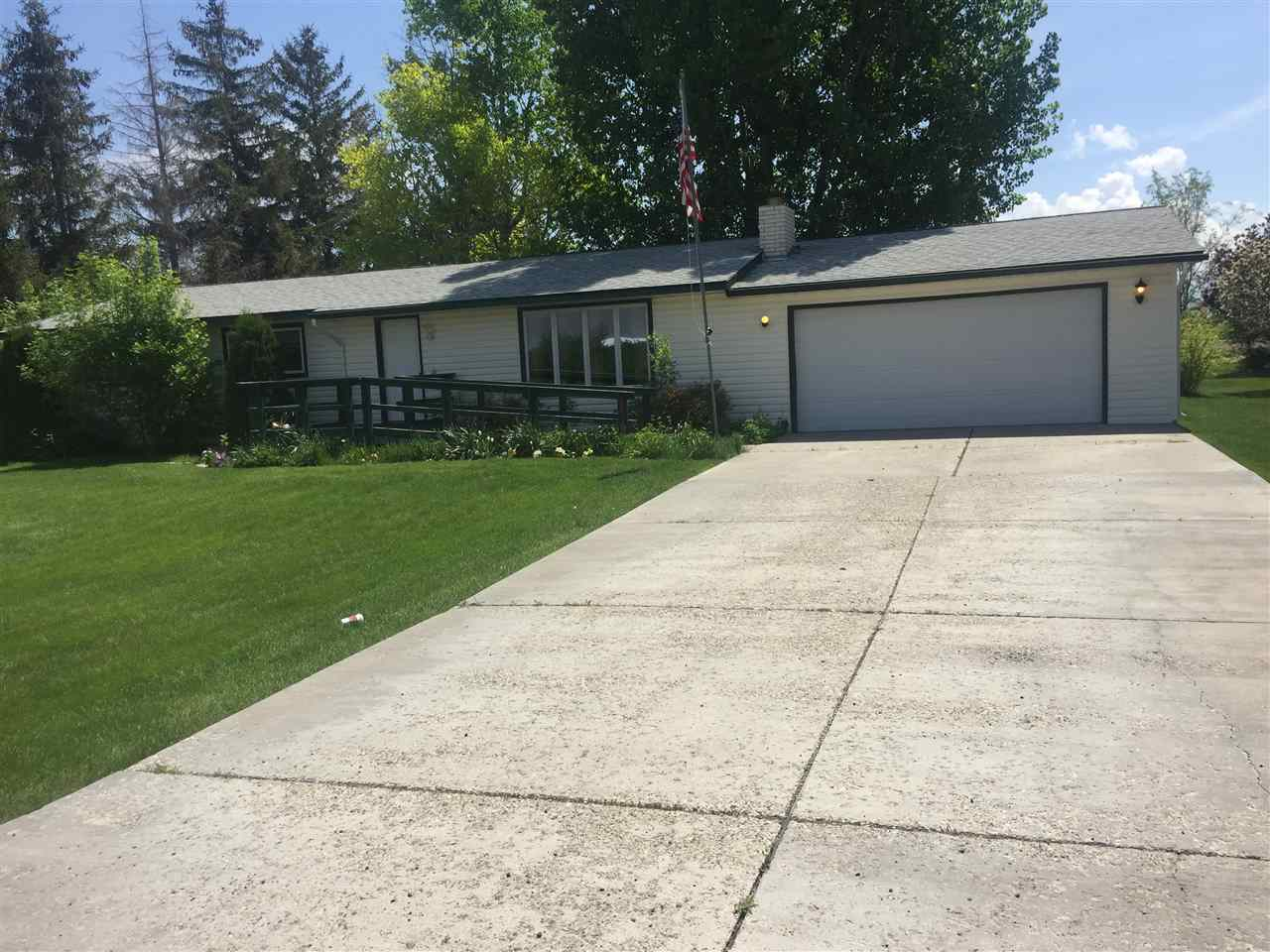 Well maintained home in Sylvan Acres SD. Large 1 acre lot with mature landscaping. Full, finished basement with a full bath. Cozy living in a very desirable neighborhood. 2 car garage, storage shed with a concrete floor. Auto matic sprinklers. This is a classic custom home.  Seller will give a carpet allowance with an accepted purchase.