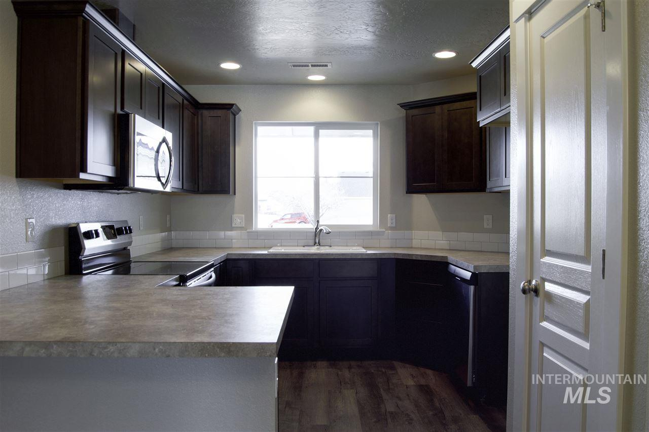 Welcome to the Crossfield Townhomes in beautiful Meridian, Idaho. This single level plan makes life easy with a great room design. Price includes traditional elevation, upgraded cabinets, vaulted great room, full sod and sprinklers, Full fencing (besides wing/gate) stainless appliances, craftsman interior trim, and many more features. RCE-923