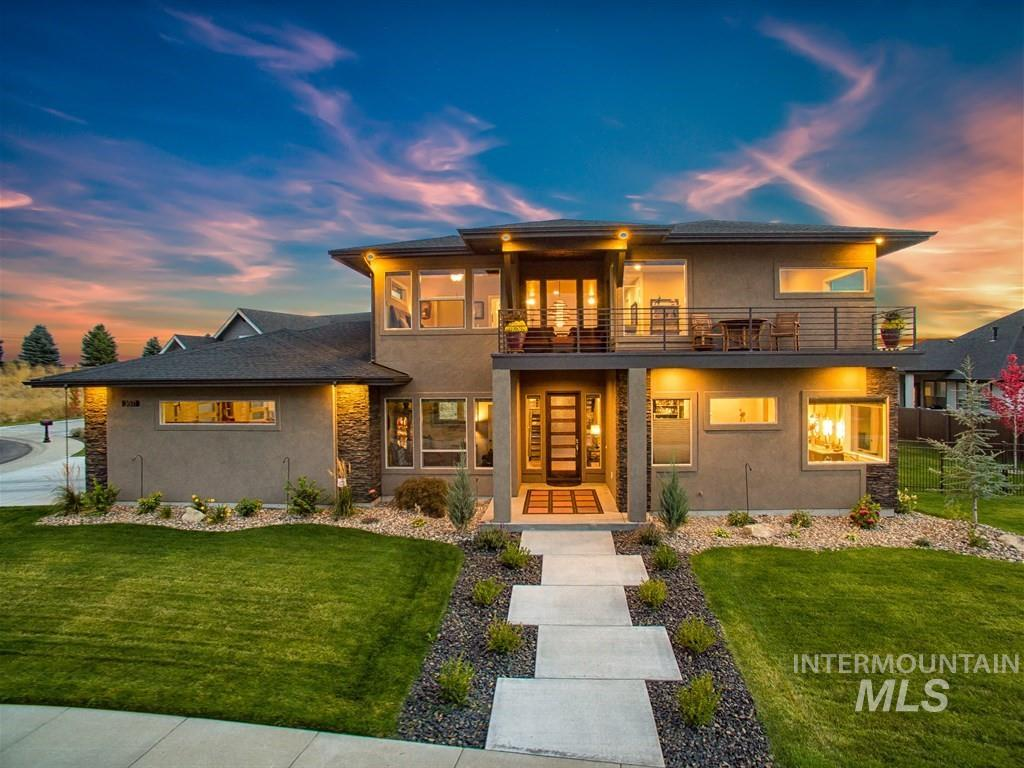 Poised to capture breathtaking views spanning over downtown skyline to the foothills. Backyard Oasis designed for indoor/outdoor living with generous patio spaces.  Outdoor dining complete w/built in grill, pergola, and hot tub.  Interior boasts open floating staircase, versatile living spaces, rich wood floors, with modern finishes.  Scores of windows let the light flow in making this home feel light, bright, and airy. Over-sized garage, perfect for trailer or boat storage: 24' D x 34' W w/9ft tall door.