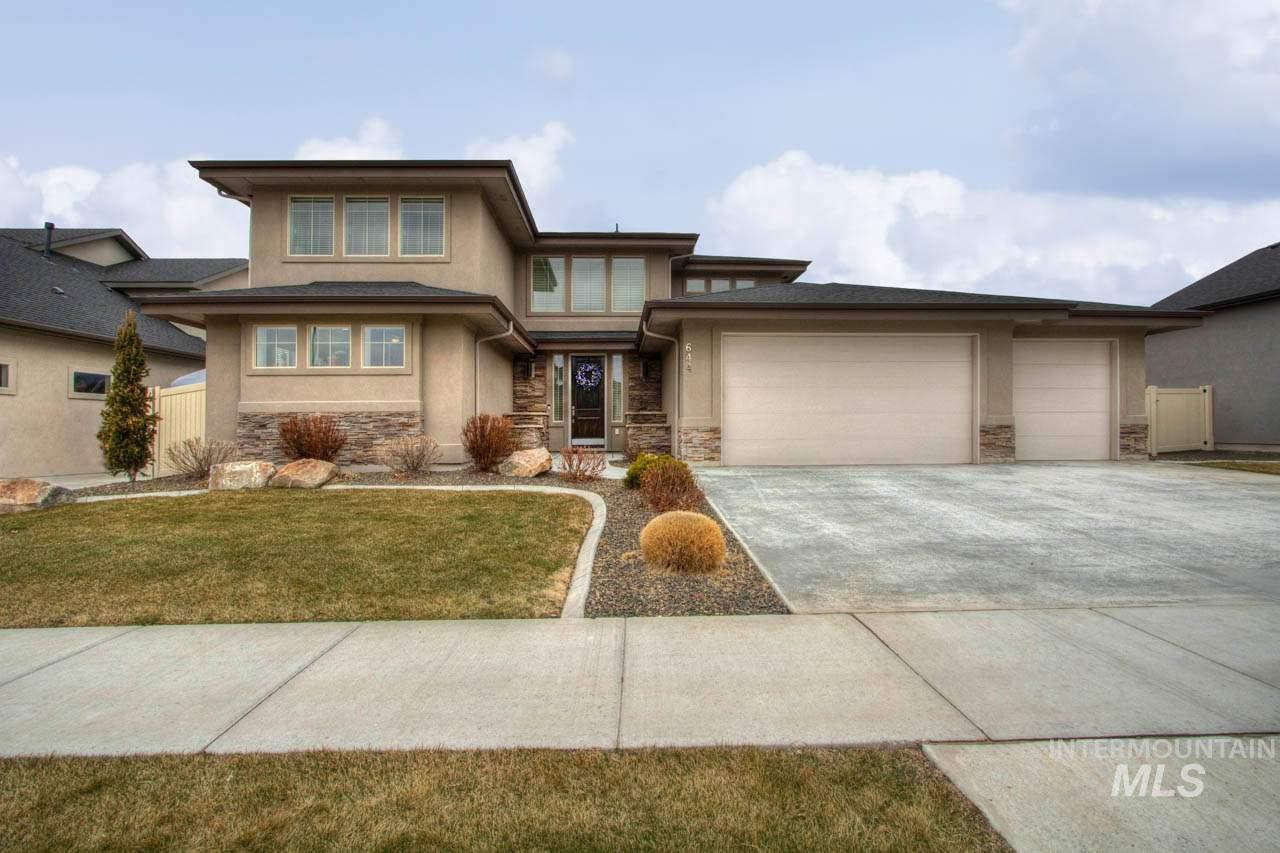 This former Parade Home is ready to impress! The welcoming entry leads to a kitchen & dining area with 20ft ceilings and high windows. The kitchen features quartz counters, two ovens, large island, & incredible storage between the wood cabinets & pantry. Master suite has a spa like bath w/soaker tub and large walk-in shower. There is a second guest suite on the main level. Large bonus room & two bedrooms upstairs. Fabulous custom backyard with pavers, fire pit, Amish built pergola, trees, & water feature.
