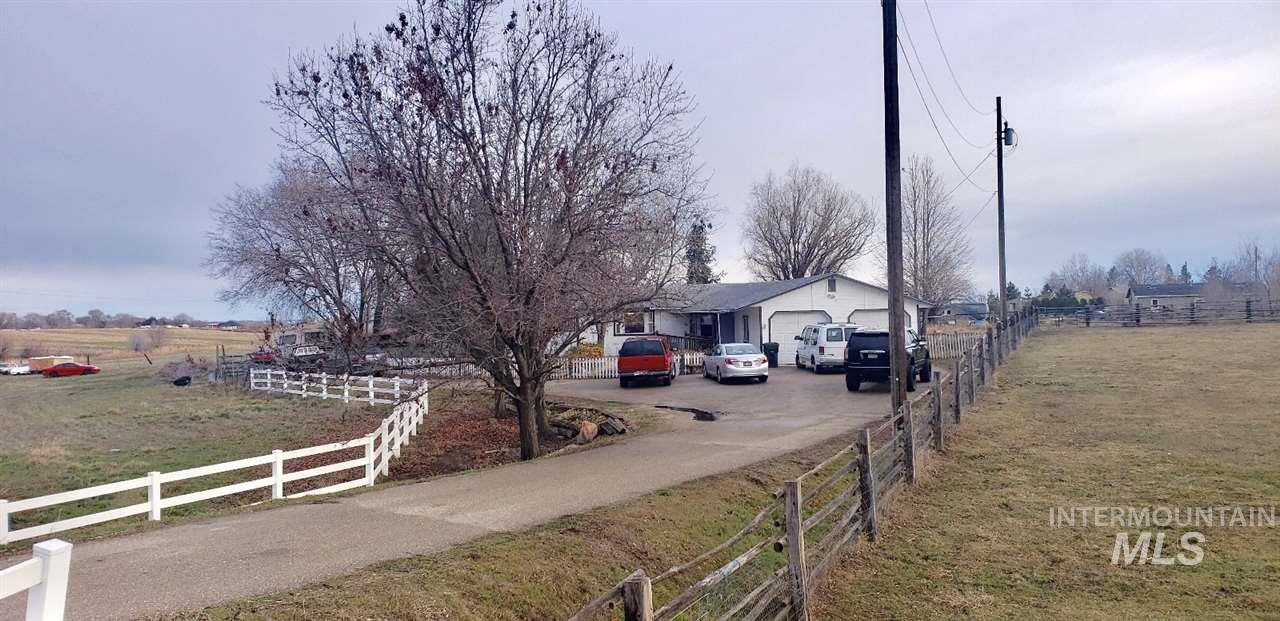 Great opportunity to own land near Middle High School. Darling single level home with 2 bedrooms, both with their own bathroom. Open great room and kitchen with covered porch. Beautiful yard with plenty of space for you to  bring your toys & animals! Great investment opportunity! Don't wait on this one!!