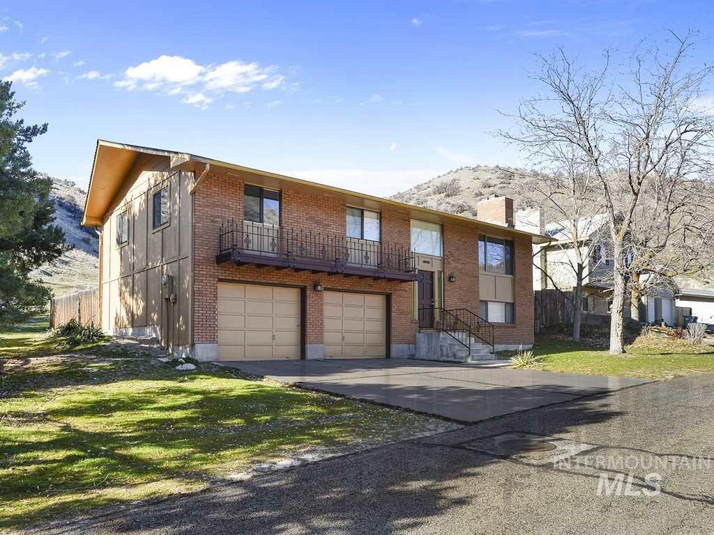 Newly remodeled with new roof, floor coverings and paint both outside and in.  This home sits at the entrance to the Pole Cat Gulch Trail Head.  The backyard is open to the foothills with no neighbors between you and the entire Ridge to Rivers trail system.
