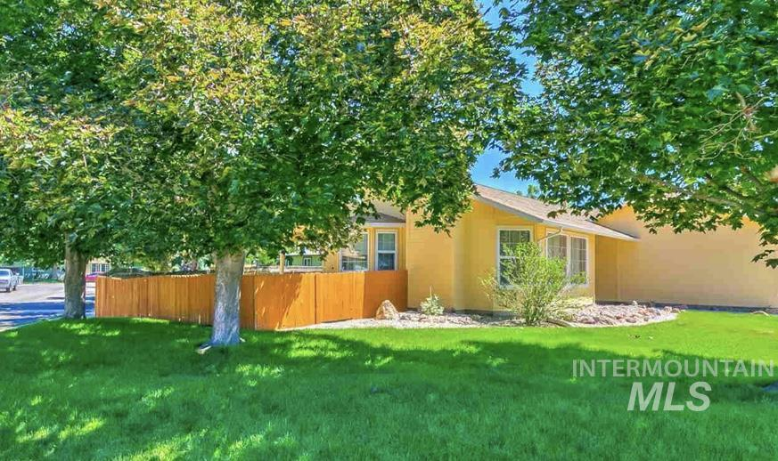 This beautifully maintained home is set on a lot surrounded by lush, mature landscaping. Open, vaulted ceilings in the entryway, kitchen, and master bedroom give an open and airy feeling throughout. Upgrades include laminate wood floors, new carpet, interior paint, and lighting. The spacious kitchen offers direct access to the covered back patio. Corner lot.