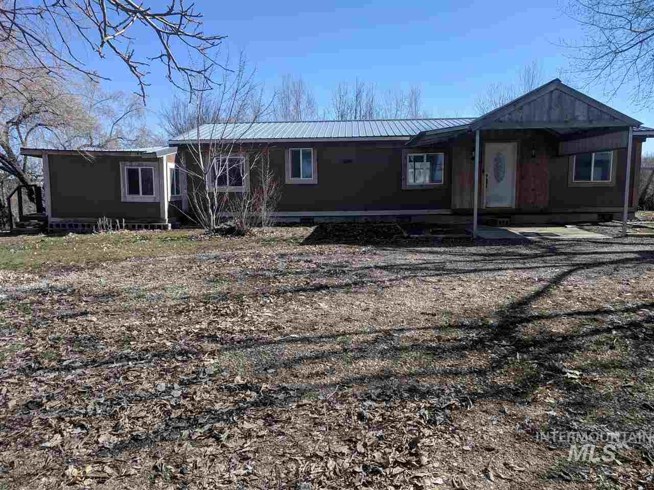 Great property with easy access to the freeway. This is a fully fenced property with two electric meters. One meter on each parcel. Property has been split, but second split was never used. Second address is 17460 (shown on plat map).