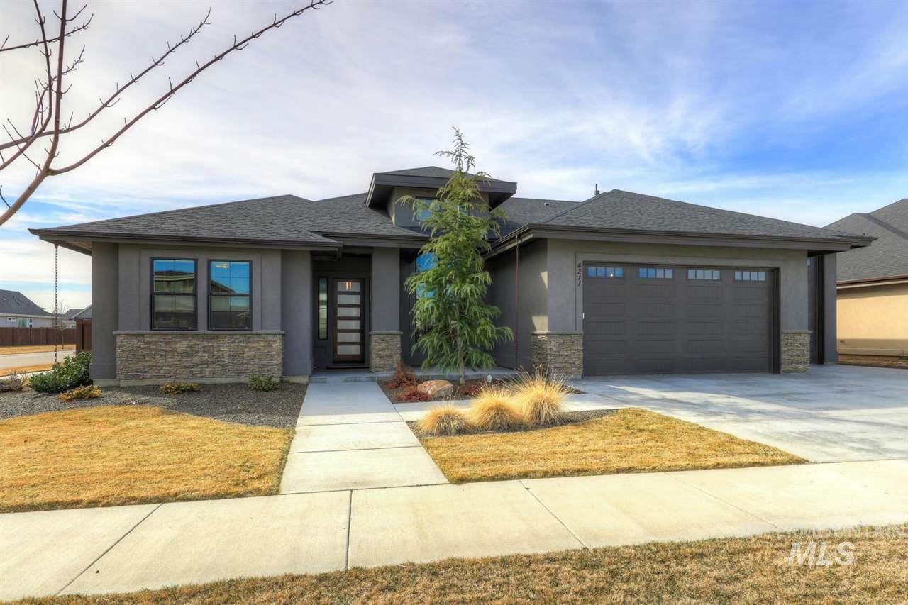 Open Sat 12-3! Delightful design showcasing an exceptional blend of craftsmanship and attention to detail. Corner lot w/ 3 spacious bedrooms + office/den. Tons of natural light w/ an upscale kitchen & adjacent great room, perfect for  entertaining. Kitchen features custom Alder cabinets w/light box uppers, full height backsplash, Quartz countertops, Bosch appliances & butler pantry. Wood floors in high traffic areas. Spa like master bath w/walk in tile shower. 12'x10'x36' drive thru RV Bay!