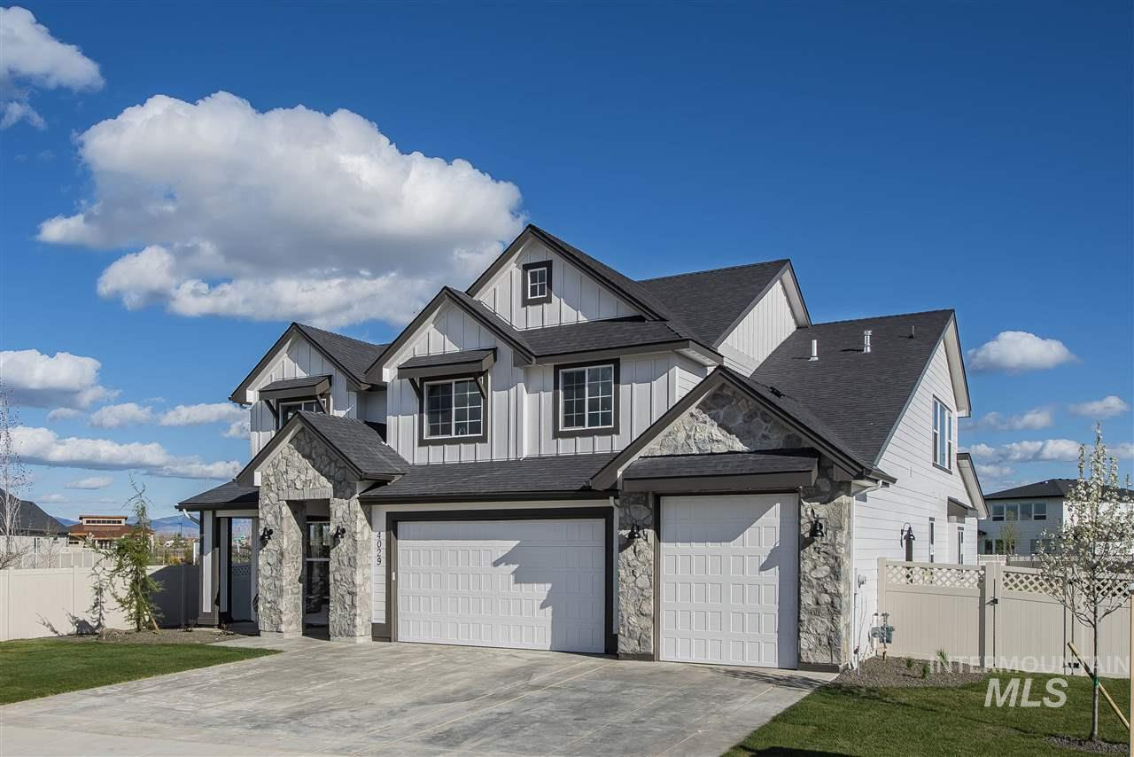 """Welcome to Eaglewood Homes Spring 2019 Parade of Homes, """"The Rainier"""". When you walk into this exquisite home you are welcomed by beautiful entry, along with an Office/Den, and a power room. As you continue in you in you will see the open-concept kitchen and spacious family room that leads right out to the huge backyard. The Master bedroom on the main level is complete with a soaker tub, walk-in shower, dual vanities & walk-in closet. This beautiful floor plan has it all. Photos Similar."""
