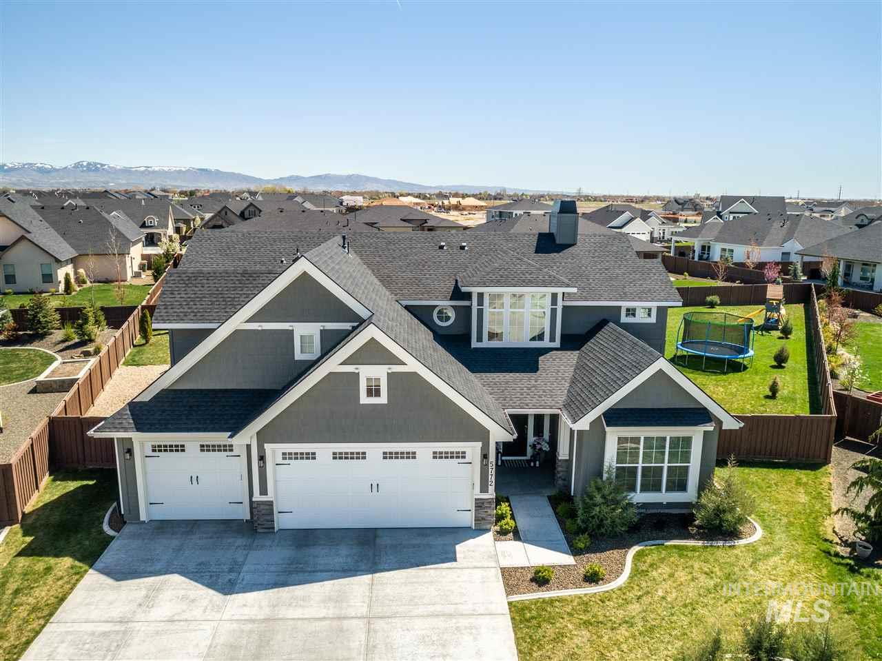 Best West facing lot in Bainbridge! Light & bright kitchen is a gourmet delight w/ pro series double fridge, SS appliances, walk in pantry, quartz countertops, island and custom cabinets. Custom built-ins and millwork throughout. Vaulted great rm features exquisite boxed beam ceiling & stylish modern fireplace. Elegant main level master w/ walk in tile shower. Wine cellar includes Kegco beer fridge. Main level office w/ barn door. Built in Traeger BBQ makes for excellent for outdoor entertaining. Lots more!