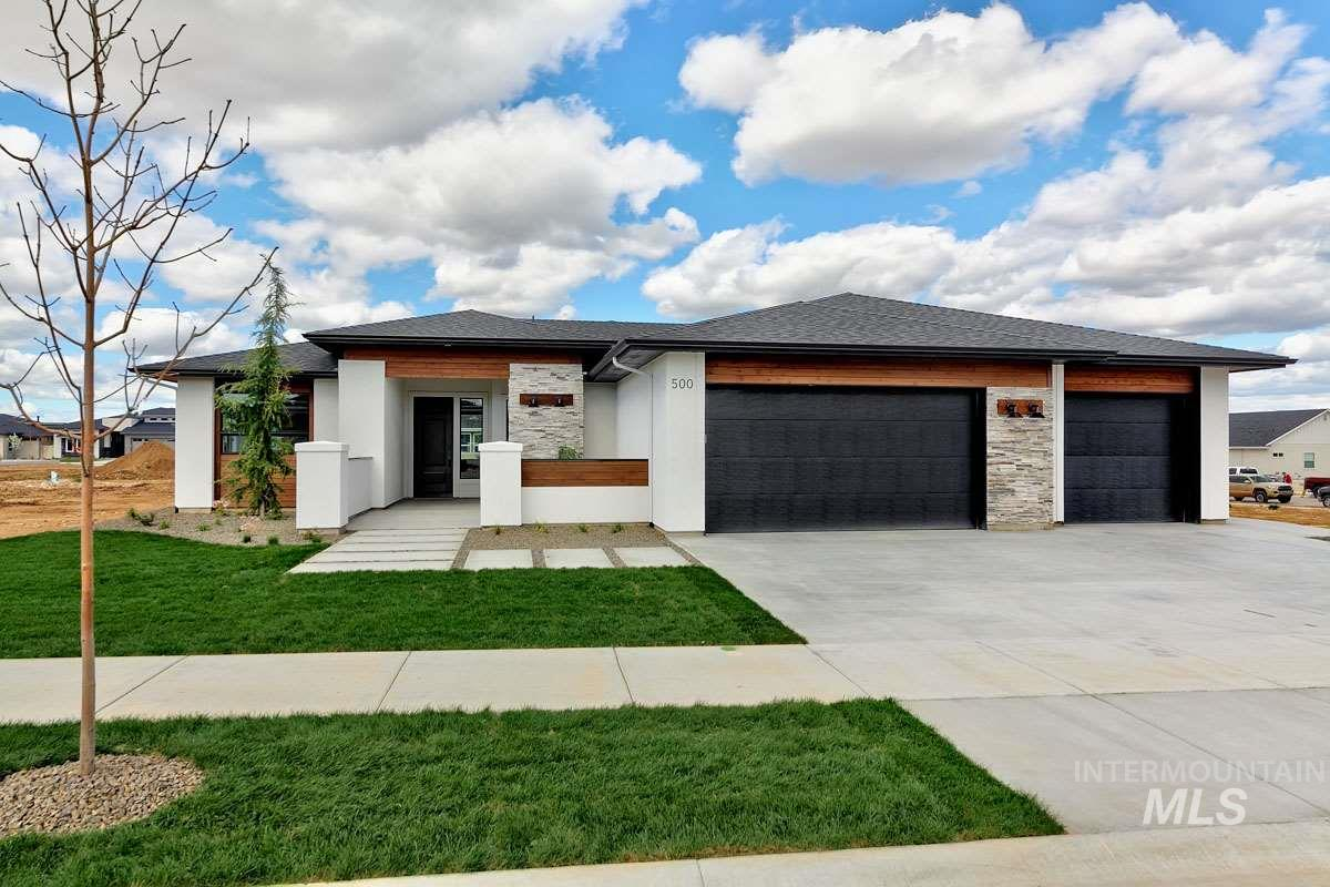 """2019 L2 CONSTRUCTION SPRING PARADE HOME. The """"Aspen"""" by L2 Construction will check every box on your list. This single-level masterpiece doesn't waste an inch of its 2287 sq ft. It's smart, it's unique and its everything you've come to expect from the team at L2. The """"Aspen"""" is not just another 3 bed 2 bath floorplan, it sets the standard for modern living in the Treasure Valley. One step inside, and you won't want to leave."""