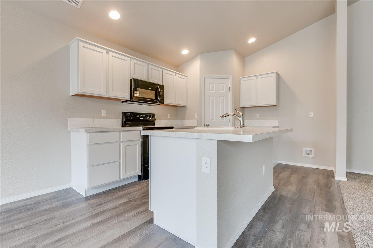 Get $5k with the Cash Boom Home Promo NOW thru 7/31.  The Olivia 1522 is just the right size for you to call home. Not only are your two bedrooms split from the master suite, all your entertaining needs are quickly resolved with an open living room layout. Master bath has stand up shower and dual vanities. Great room is nice sized with vaulted ceiling. Kitchen with SS appliance, subway tile backsplash and large corner pantry. Photos similar.  RCE-923