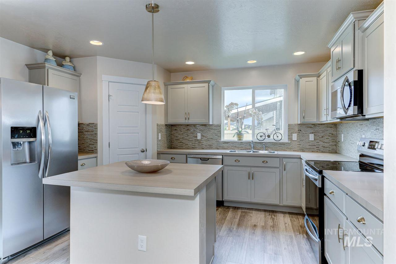 Better than NEW open floor plan boasting 2,265 sqft + $10,000 in builder upgrades! Stunning kitchen, soft-close cabinets, stainless steel appliances, full tile backsplash, hard-surface flooring, pantry, center island, large dining area & more! Master suite offers bay window, walk-in closet & dual vanities. Spacious loft bonus area. Inviting fireplace. Main-level bedroom. Fully fenced & landscaped. Family friendly community, walking paths, playgrounds & easy access to local schools.