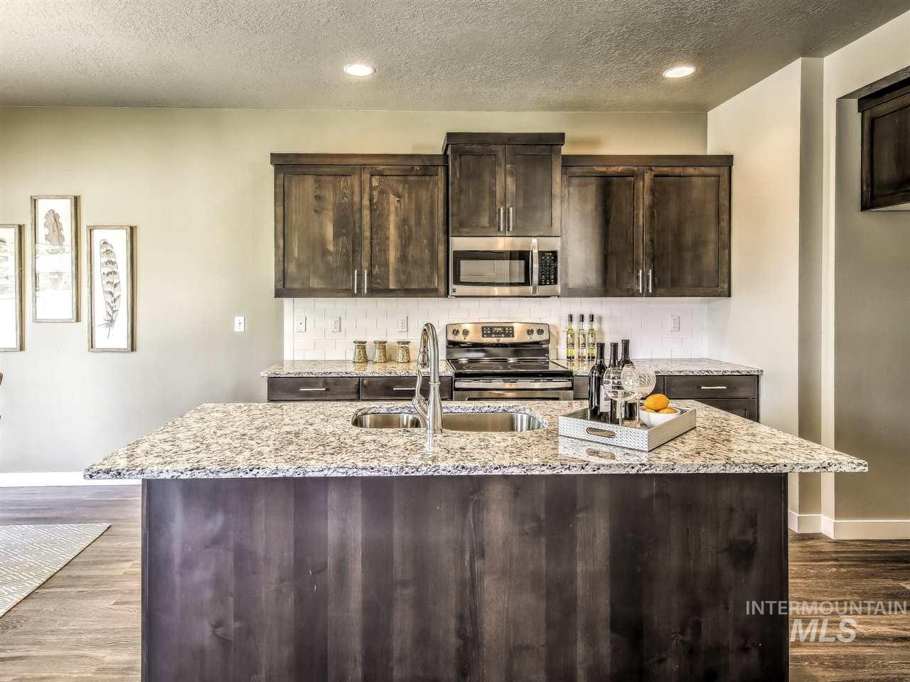 "Sedona | Blackrock Homes. Completion date is 06/20/19. Dark stained kitchen cabinets, gray quartz counters, Brushed Nickel Hardware & Fixtures. Built-in bench & cubbies, custom cabinets w/ full tile backsplash, SS appliances & secret ""mouse hole."" Large master suite upstairs w/ dual vanity + 3 more bdrms & a loft that flexes as 2nd TV area. Dual vanity at main bathroom.  Pics and tour similar. LANDSCAPE MAINTAINED BY HOA, NO MOWING!!"