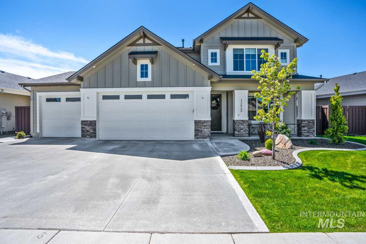 Stunning, upscale home in the highly sought after Paramount Subdivision! The luxurious kitchen features upgraded appliances, quartz countertops & hardwood floors overlooking a gorgeous fireplace surrounded by built-ins. Upstairs you'll find a gorgeous master w/trayed ceilings. Backyard backs up to a common area. Oversized 3-car garage, 2 blocks from the community pool & 1/2 mile to the high school. Downstairs office is actually a bedroom. 4th/largest room upstairs can be media room/bonus.