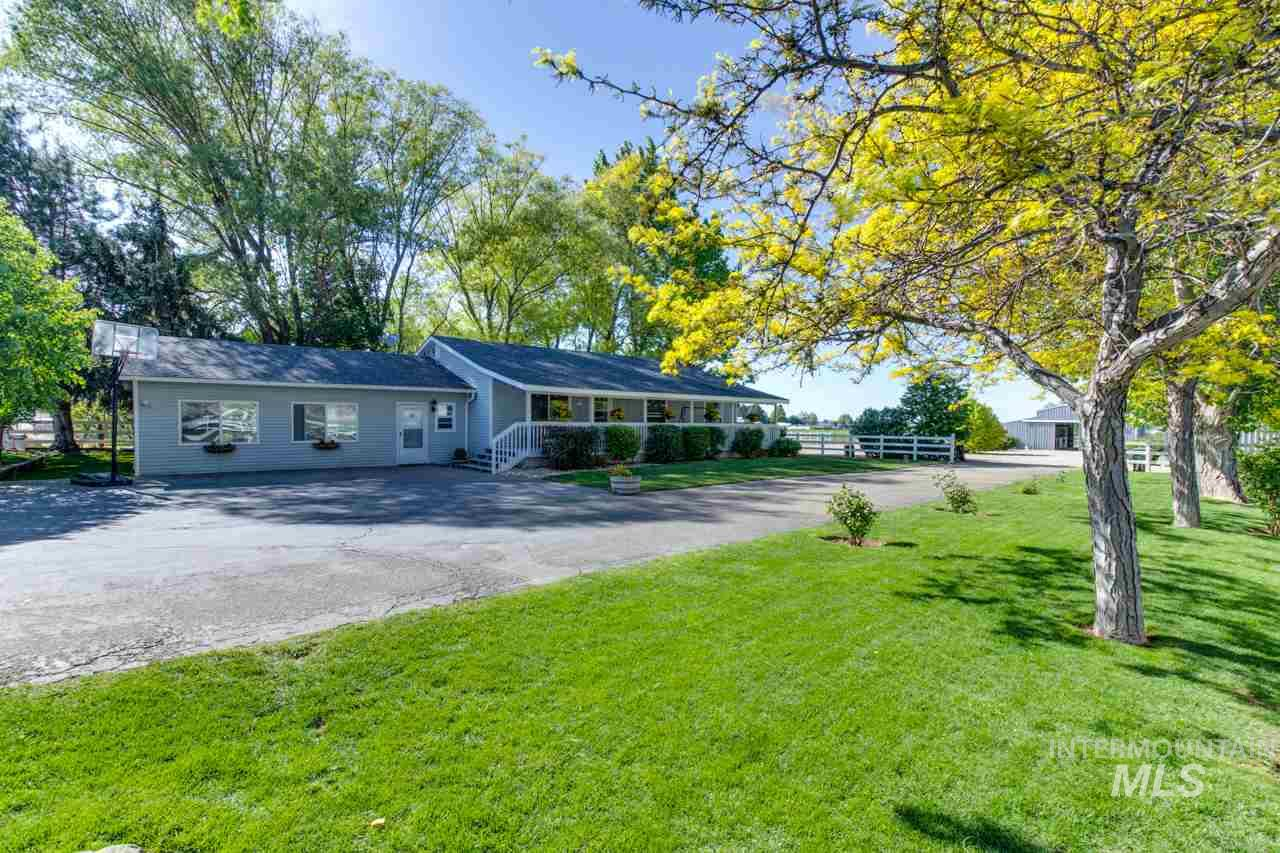 Rare Horse Property, located w/in a ONE mile ride to BLM land & minutes to Kuna & I-84. Enjoy the peace & tranquility of this 6.3 acre property, lined w/mature trees & views of the mountains. The almost 2000 SF home features a very large family/rec room to enjoy a quiet evening at home or large gatherings w/your guests! You & your guests will also enjoy the large riding arena & 6-stall horse barn w/tack room, wash bay & large covered shop for hay storage.See docs tab for more information.
