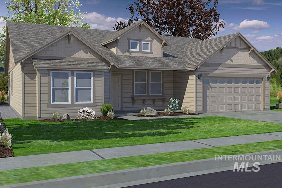 """The """"Snowbrush"""" offers a beautiful open concept, w/eating bar and large island in the kitchen for all your cooking and storage needs. Vaulted ceilings and tons of windows let the light pour in! Master bath offers dual vanities and a massive closet."""