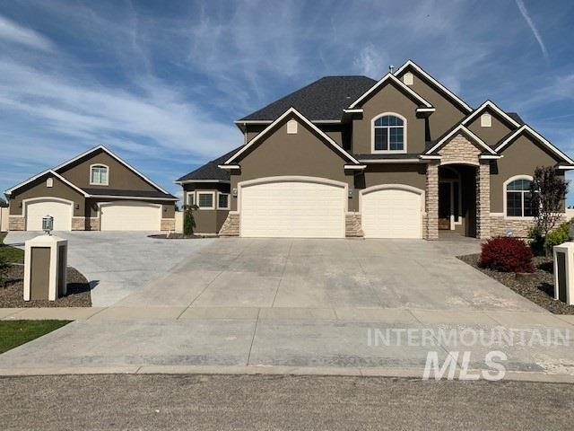 5,026 total sqft combined House and In-Law Suite. 3446 sq ft home on 1+ acre in beautiful up-scale sub. Contemporary. kitchen, laundry room w/ storage. Lg mstr on main floor w/ library. Mstr bath has dual vanities, walk in-shower, jetted tub. Four bdrms upstairs, game room and 2nd ldry room. 1580 sq ft In-law suite includes lg room w/full bathroom, living room, lndry closet w/ hook-ups, kitchen, ductless heat/AC, movie theater (w/ separate entrance), large bonus room upstairs and a 3 car garage/shop (40x30)