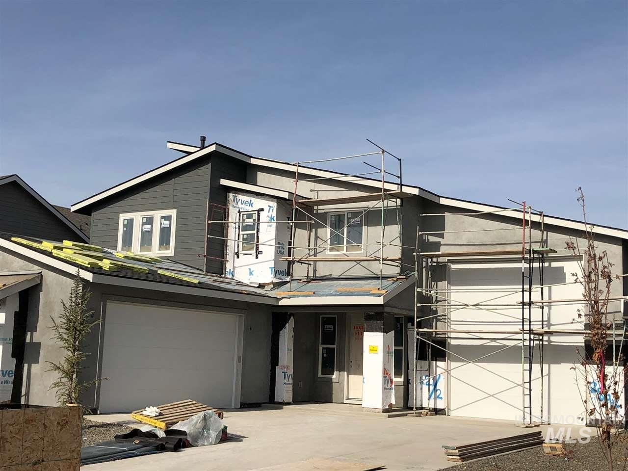 The Lemhi is a perfect example of an efficient design. Enter the home to a beautiful entry and flex space. Upstairs features 3 bedrooms and a loft space. The garage features a 2 car bay separate from the 47' RV Bay with a 14' door. The open kitchen, great and dining room flow seamlessly together. The master suite features His & Her Closets and a tiled walk-in shower. The Sky Mesa Community offers amenities for an active lifestyle, infinity edge community pool, close to schools, shopping, and the freeway.