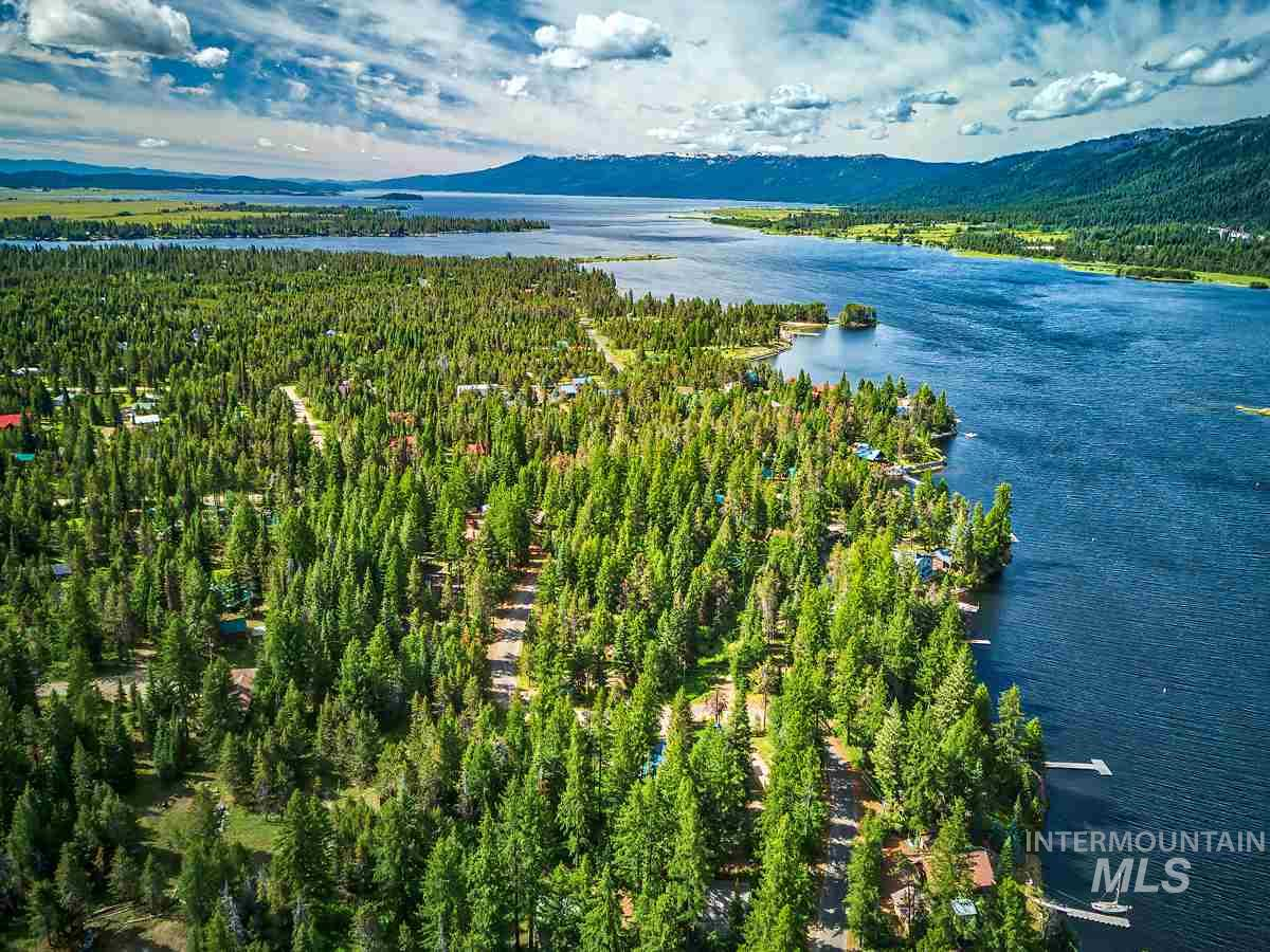 Build your mountain retreat in the highly desirable Wagon Wheel Sub, just a stone's throw away to Lake Cascade! Oversized 1.51 lot is level & ready to build w/ample trees to provide privacy & abundant opportunities for viewing wildlife. Year round access allows for year round living or the perfect weekend getaway. Prime location w/easy lake access, miles of trails & endless recreation opportunities. Minutes to Donnelly & McCall. Electric & sewer installed to property line, paved street, RV/Camping allowed.