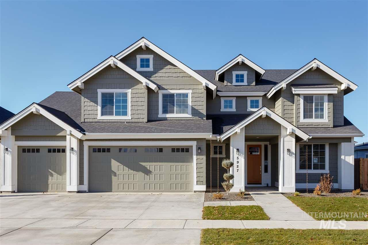 Welcome home to the Bannock with guest suite, built by Alturas Homes. The guest suite resides on the main floor with an attached bathroom. The home features coffered ceilings, a large upper bonus, five bedrooms an office, as well as storage under the stairs.