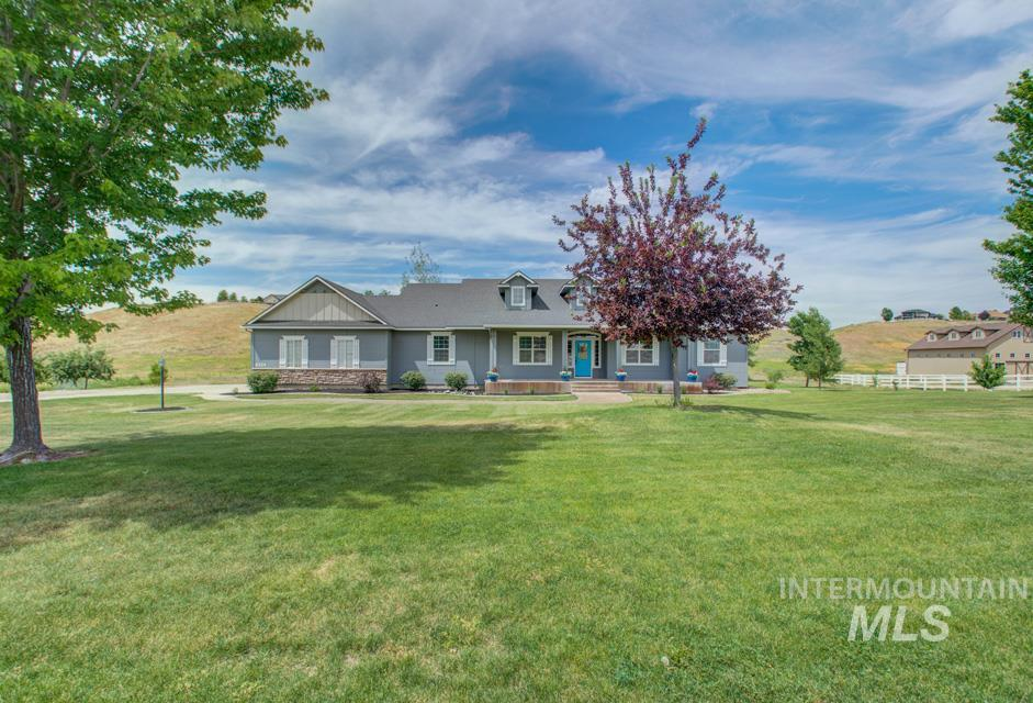 Welcome to this beautiful custom home on 3.76 acres with so much to offer.  Large kitchen opens to the living room w/ gas fireplace. Master includes sitting area, dual vanity, soaker tub, dual head shower & extra-large walk in closet. Plenty of space to spread out with formal dining, office, sitting room & mud room. Walkout basement has a large recreation room, theater room, two bedrooms, bathroom & large storage room. Privacy on this lot with no back neighbors. Call today to view. See aerial video.