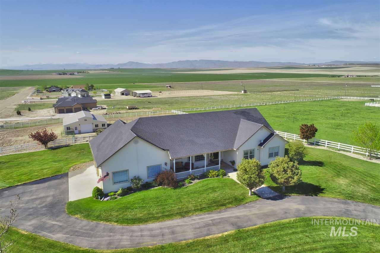 What more could you ask for? Beautifully maintained home w/views of the Owyhees. This home boasts 5 large bedrooms,4 baths, theater room, office and so much more. There is a new 4 stall barn complete w/110 & 220 power, automatic waterers and tack room. A 40x48 shop w/110 & 220 power to store your Class A motorhome and tractor. Pasture has underground irrigation for your horses and livestock. Don't miss the chicken house too! This property will sure to please your most discriminating client.