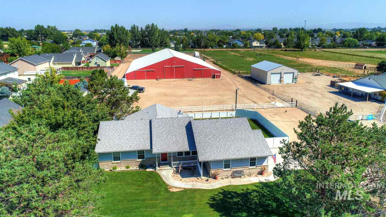 Horse Enthusiast Dream Property! Immaculate 3 bedroom/2.5 bath home with your own personal Indoor Barn & Riding Arena. 120' x 150'. 9 stall barn with 2 runs & 2 tack rooms on each side.  Plenty of room for truck & trailer parking.  Small outdoor riding area located towards back of property.  Irrigation available to turn into pasture. Ideal location close to schools & shopping.  New Vinyl fencing around home and back yard. Very unique and extremely rare piece of property! This is a must see!!