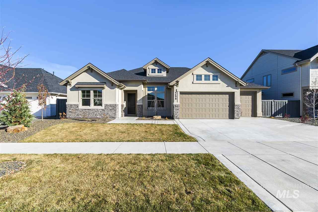 """PHOTOS SIMILAR The """"Brinton Carter"""" by James Clyde Homes. All the bells and whistles you've come to expect from James Clyde: Extensive hardwood, amazing stainless steel Thermador appliances, custom built cabinetry, breathtaking trim work & detail that only a true craftsman can deliver! Check out the oversized (over 1,350 sq ft) 4+ garage that features a 45' long 3rd bay w/epoxy flooring! Full landscaping front & back! BTVAI"""